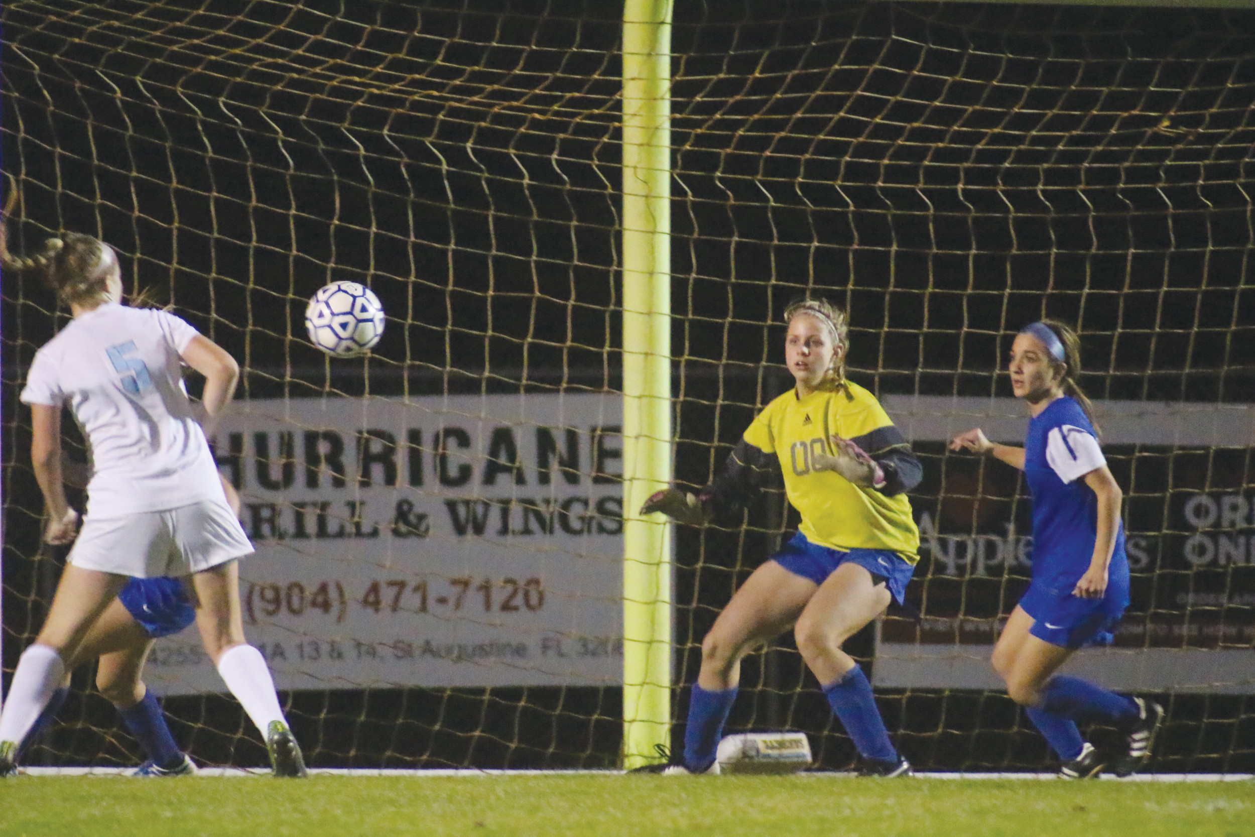 Clay high goalie Taylor Hosek, in yellow, and defender Taylor Fabiani react to a shot on goal by Ponte Vedra in Lady Blue Devils' 3-0 loss in the district 4-3A championship on Friday. Clay advances as runnerup to play Stanton Prep on Wed., Jan. 20 in Jacksonville.