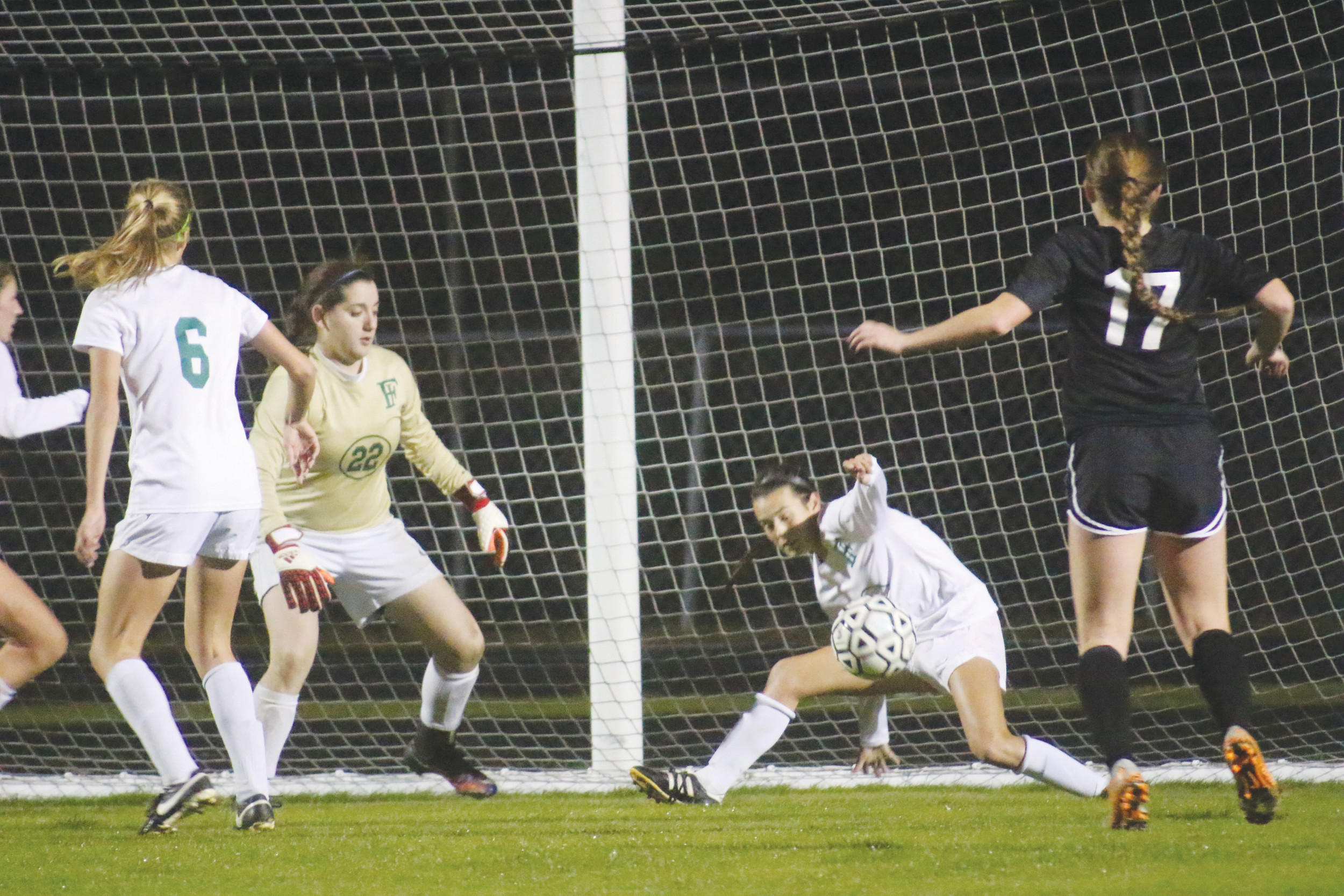 Fleming Island goalie Sam Materazzi and defender Morgan Carmichael try to avoid a Nease goal in Golden Eagles 3-2 overtime loss in the district 4-4A semifinals on Friday.