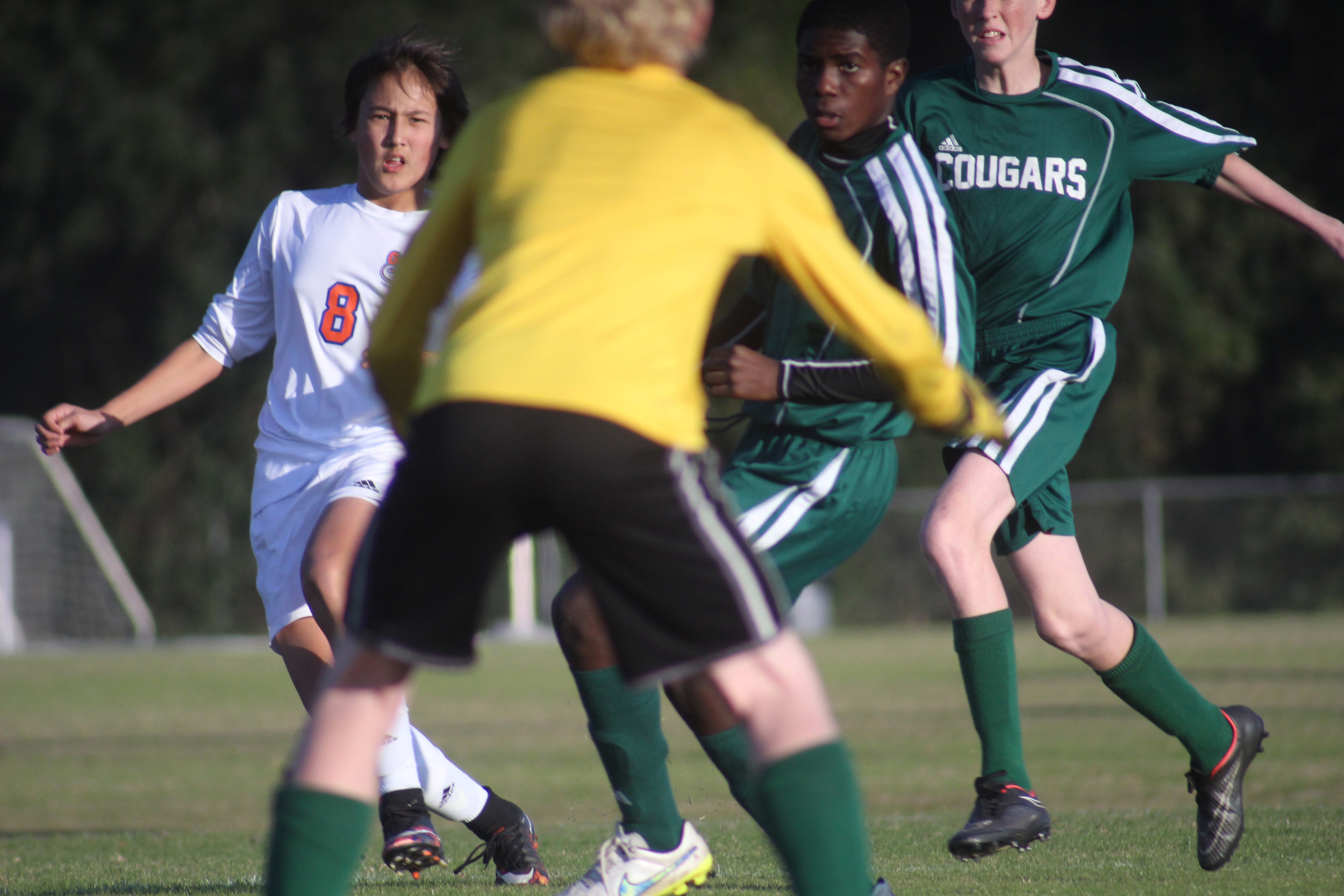 Lakeside Junior High won 8-0 over Green Cove Springs to advance to championship on January 28 against Lake Asbury. Shown is Trey Weeks shooting on Cougars in first half action.