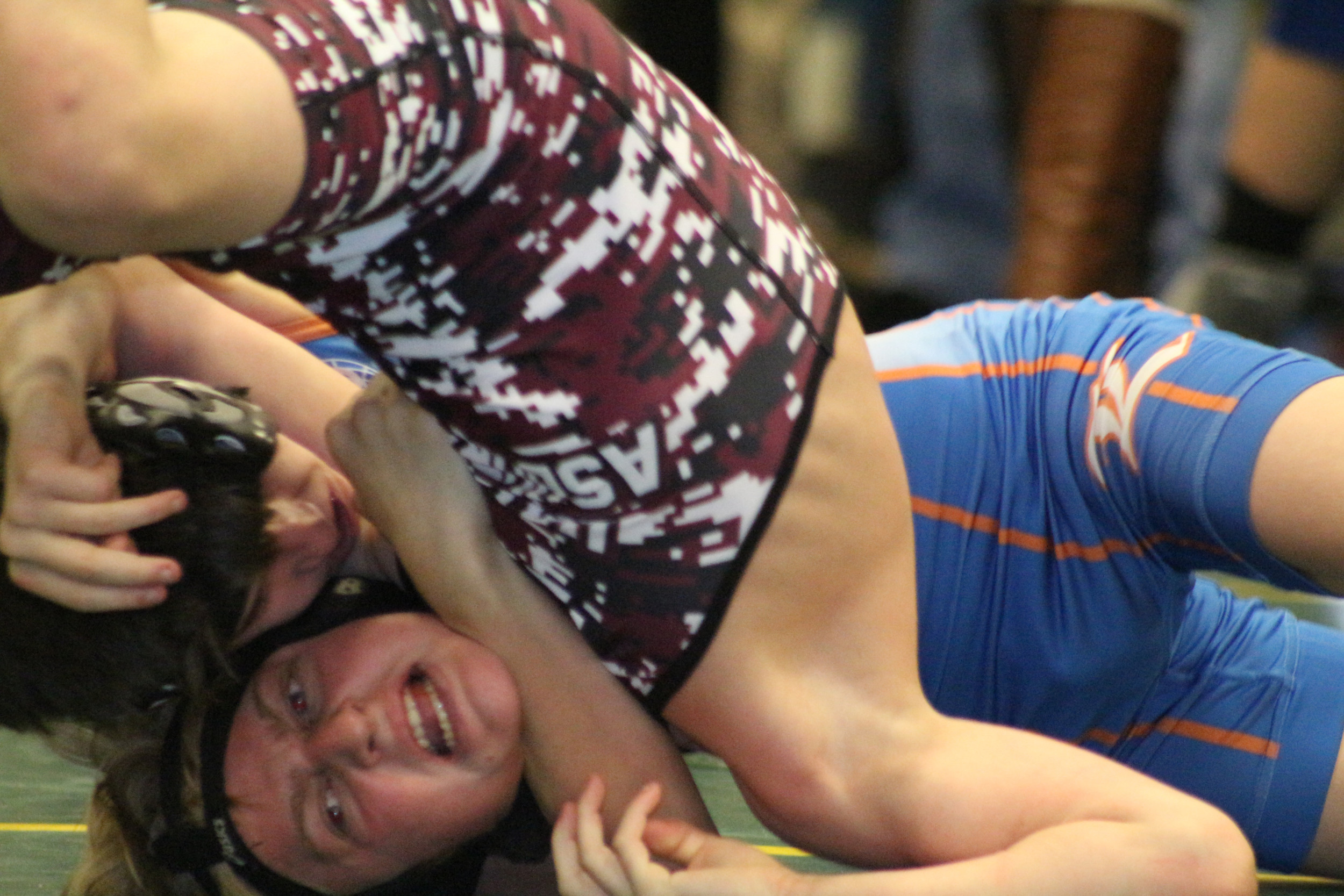 Lakeside Junior High wrestler JoJo Donato has a hard hold on Lake Asbury's David Graham in quarterfinal round of Lake Asbury Junior High Invitation. Donato won match and finished second in his weight division.