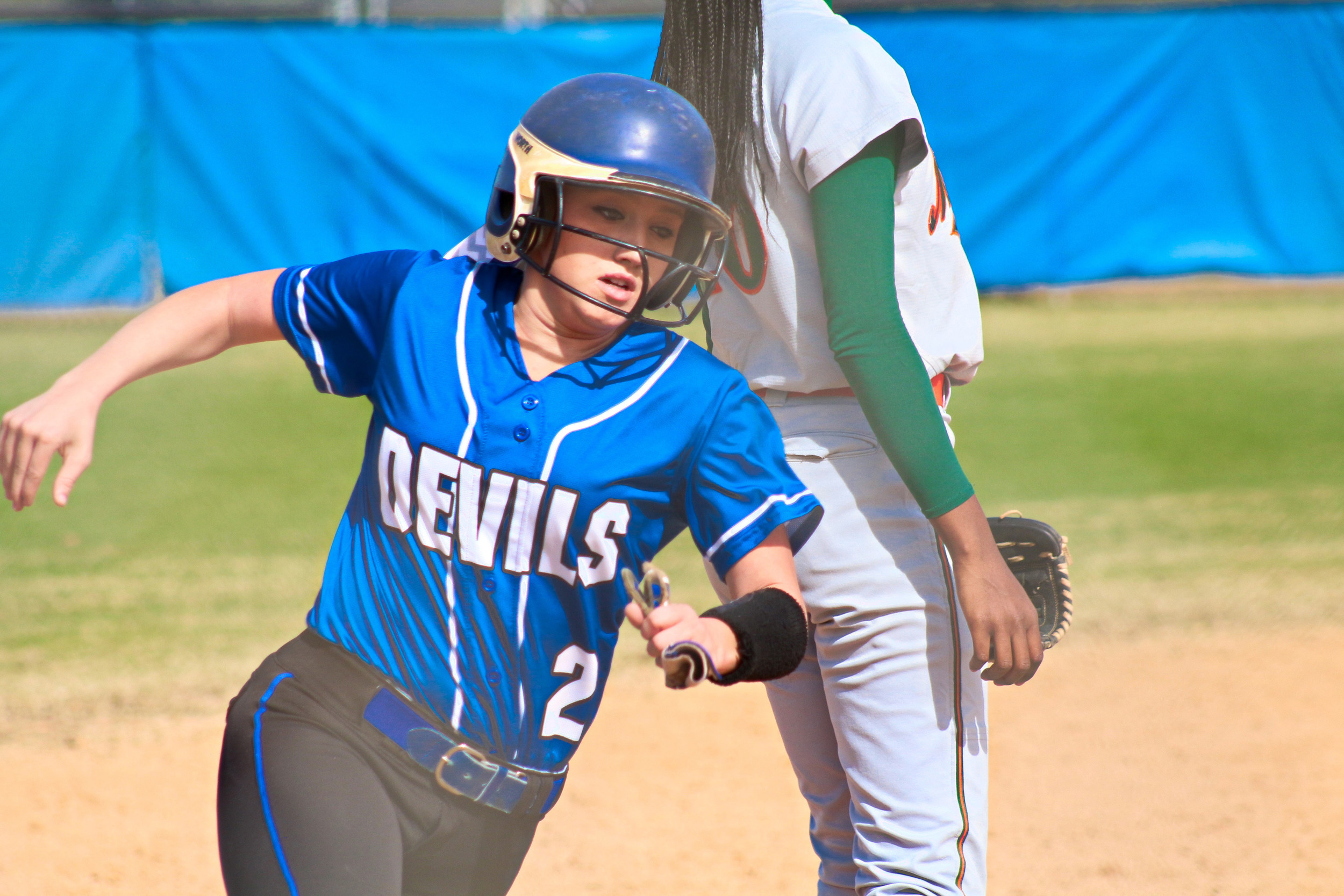 Clay High second baseman Katlyn Morgan rounds third in Blue Devil win over Orange Park.