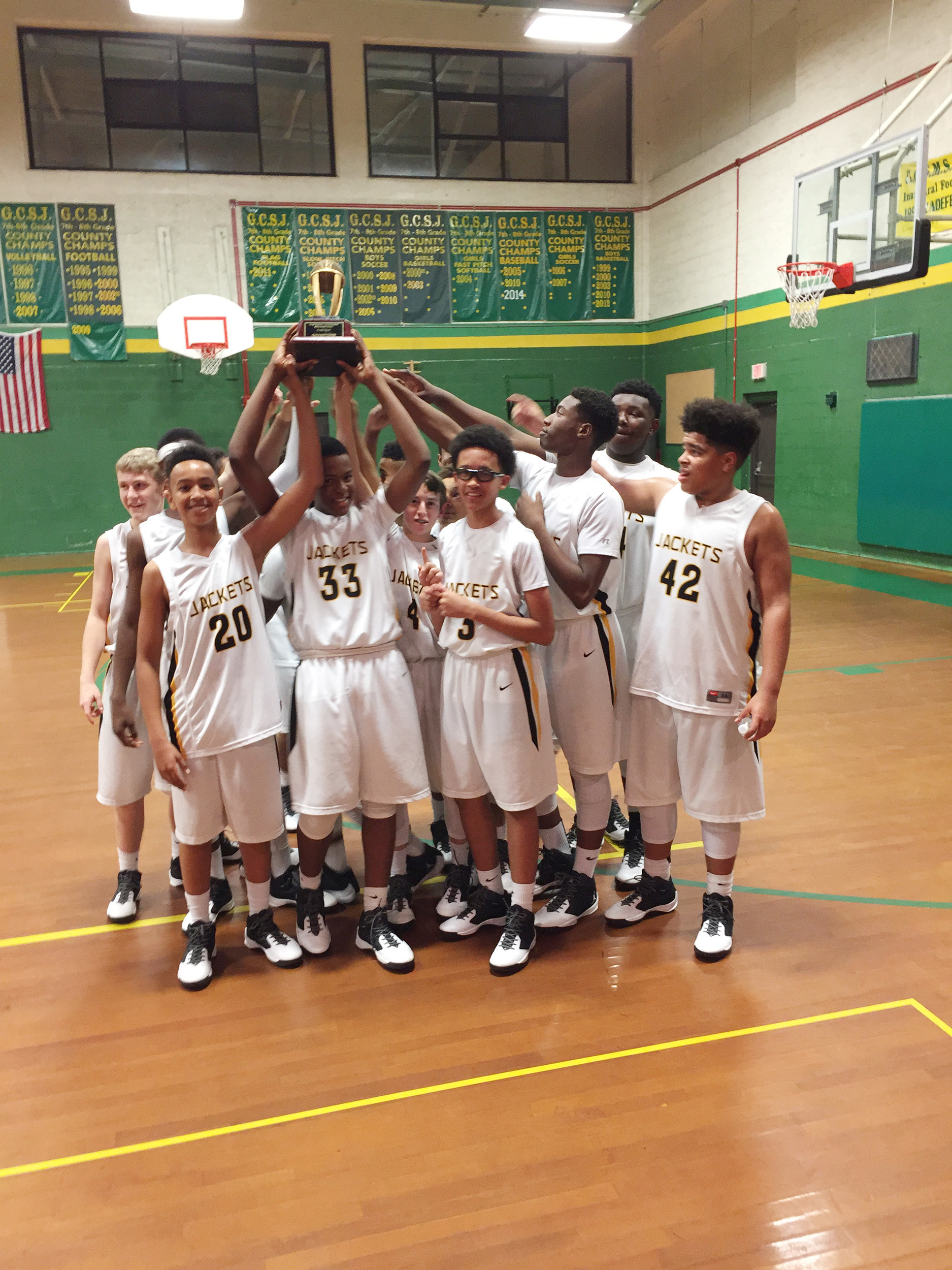 Bottom: Oakleaf Junior High's boys basketball team won 47-30 over Bradford Middle School for the Clay County Championship. The Yellow Jackets, coached by John Conley, finished with a 14-0 record.
