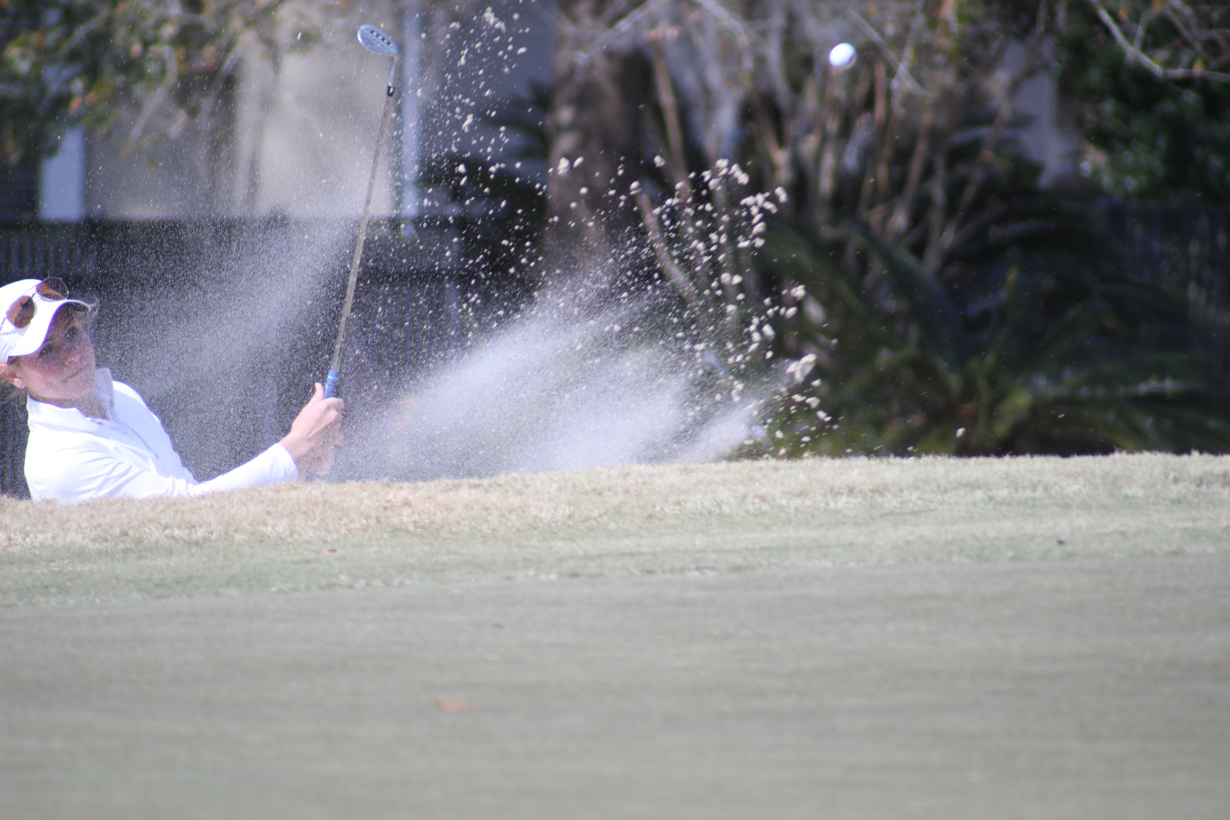 Fleming Island High golfer Lauren Waidner blasts out of sand bunker on fourth hole at Eagle Harbor Golf Course. Waidner finished eighth in girls 14-18 division.