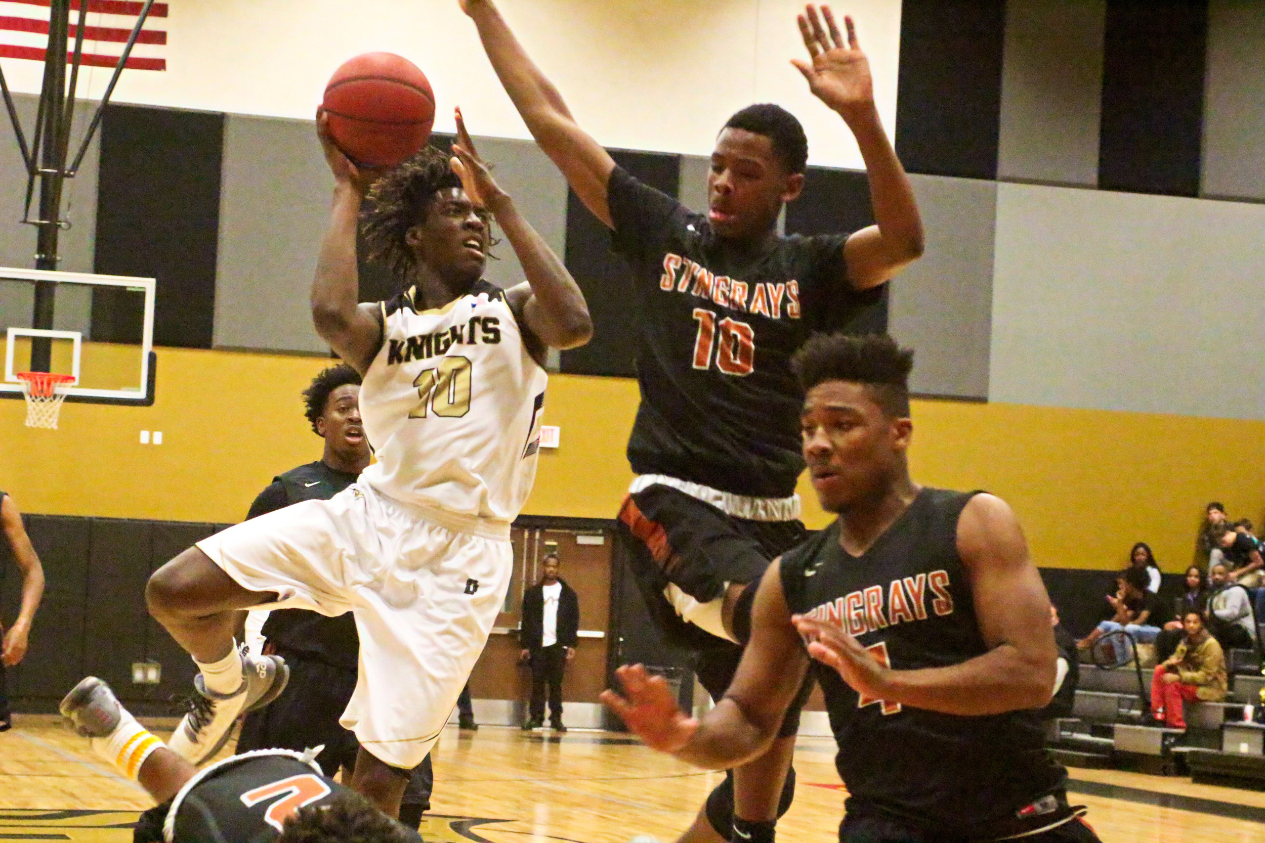 Oakleaf High forward Nassir Little is in defensive traffic in Knights 51-46 overtime loss to Atlantic Coast in region quarterfinals.