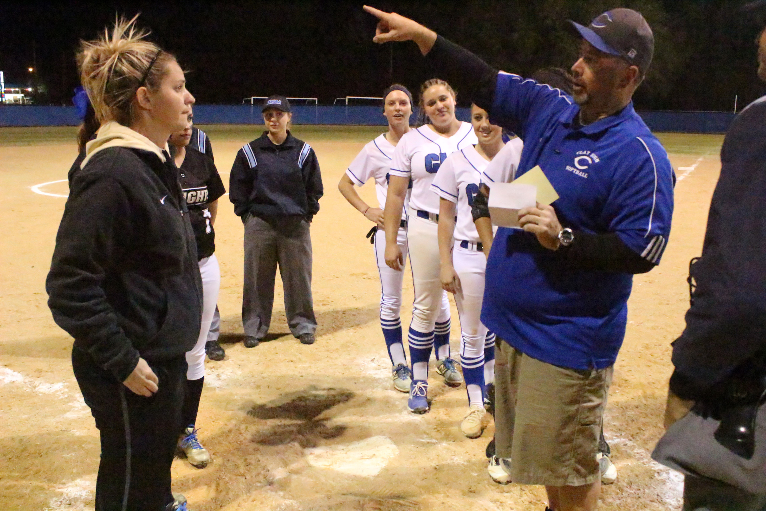 Clay High coach Matt Lewis, right, points out field regulations to Oakleaf High coach Christine Thompson before Knights 3-0 win Friday night. Thompson was a player for Lewis on Clay's 2001 state championship team.