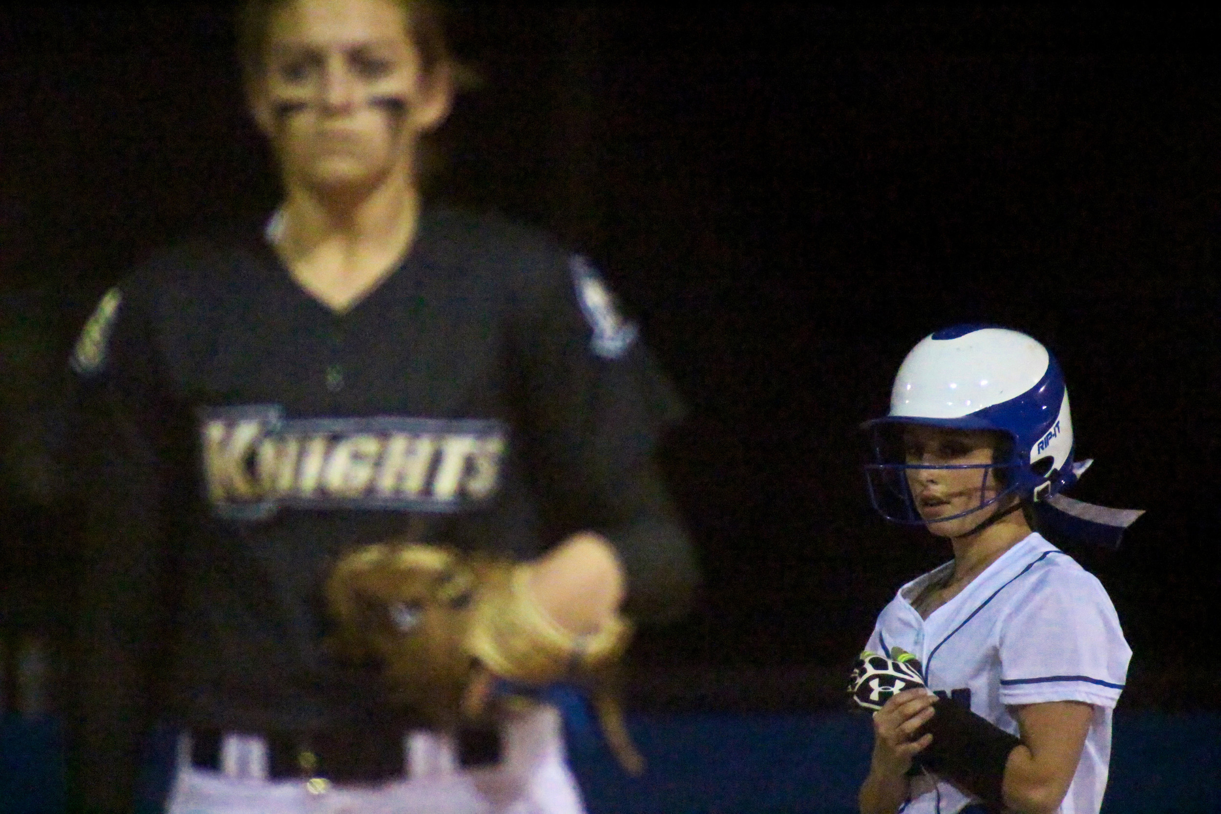 Clay High baserunner Allison Byrd stands on second base late in the Blue Devils 3-0 loss against county-rival Oakleaf as Knights pitcher Kelsey Sweatt sets to pitch. Byrd got to third base but was unable to score.
