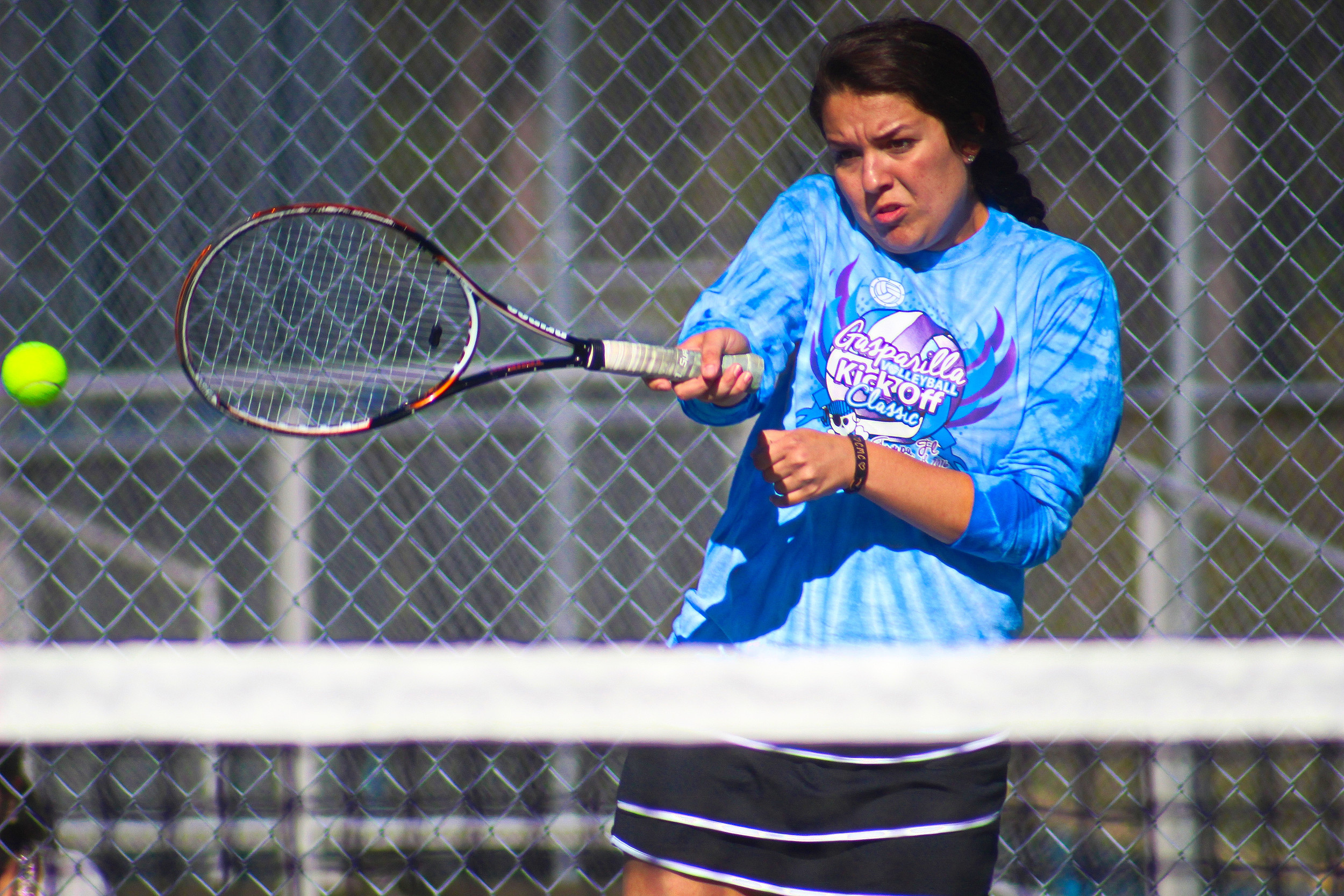 Ridgeview High's Emily Smityh strokes ball back in doubles action against Middleburg.