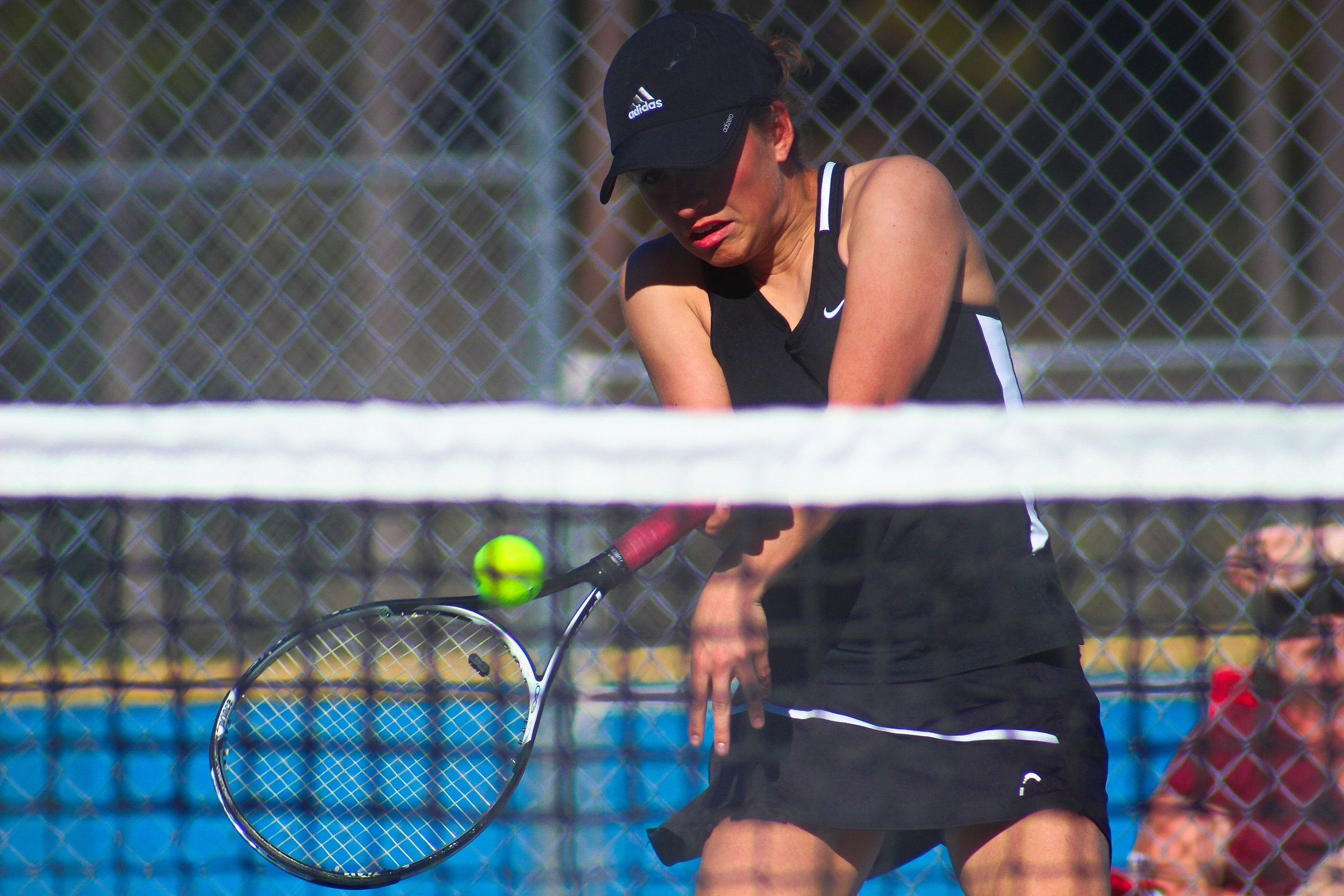 Ridgeview High's Elaine Fulger gets a strong shot in doubles action against Middleburg.