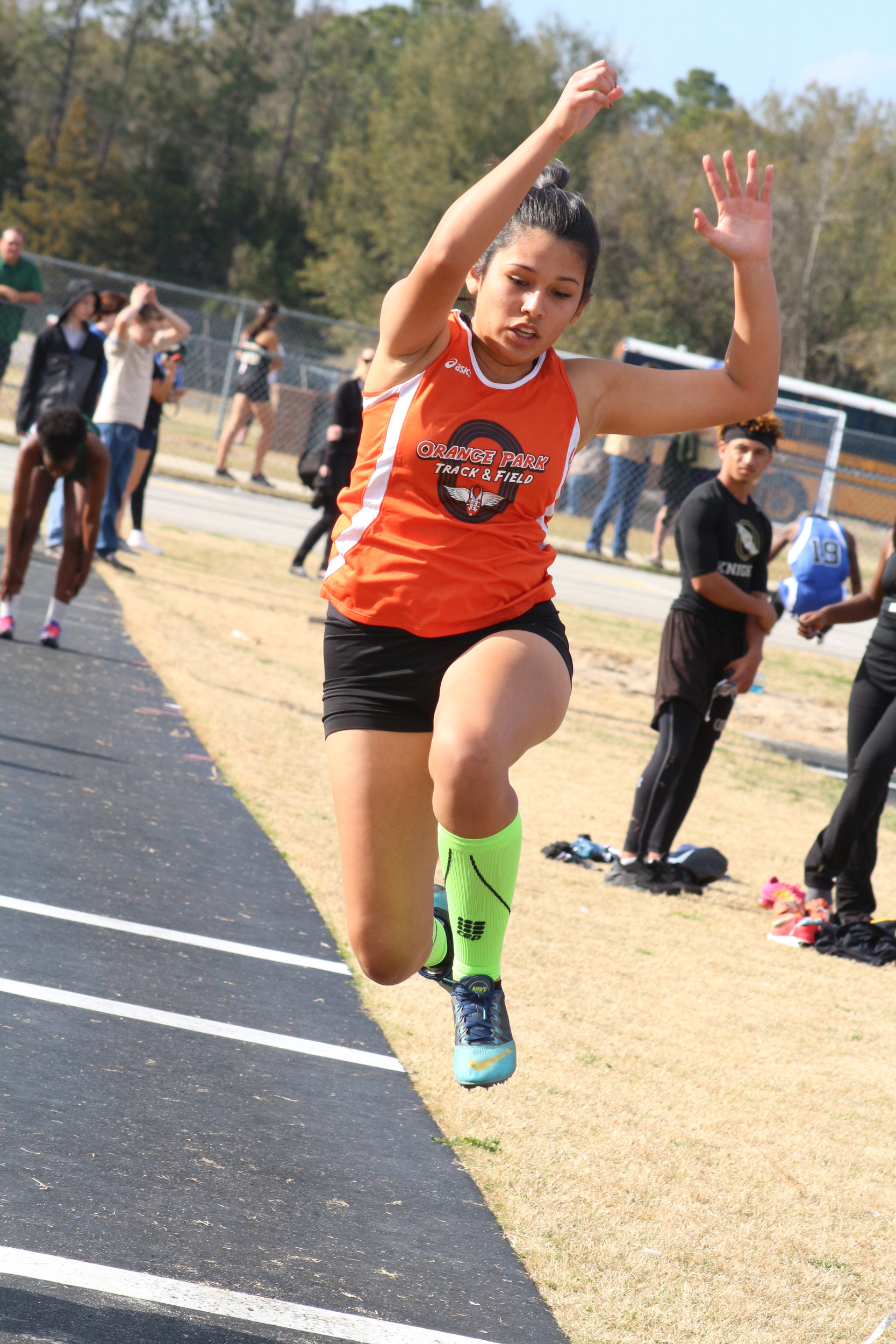 "Orange Park long jumper Lillian Adriano leaps to a 14'-2""  mark for 11th place."