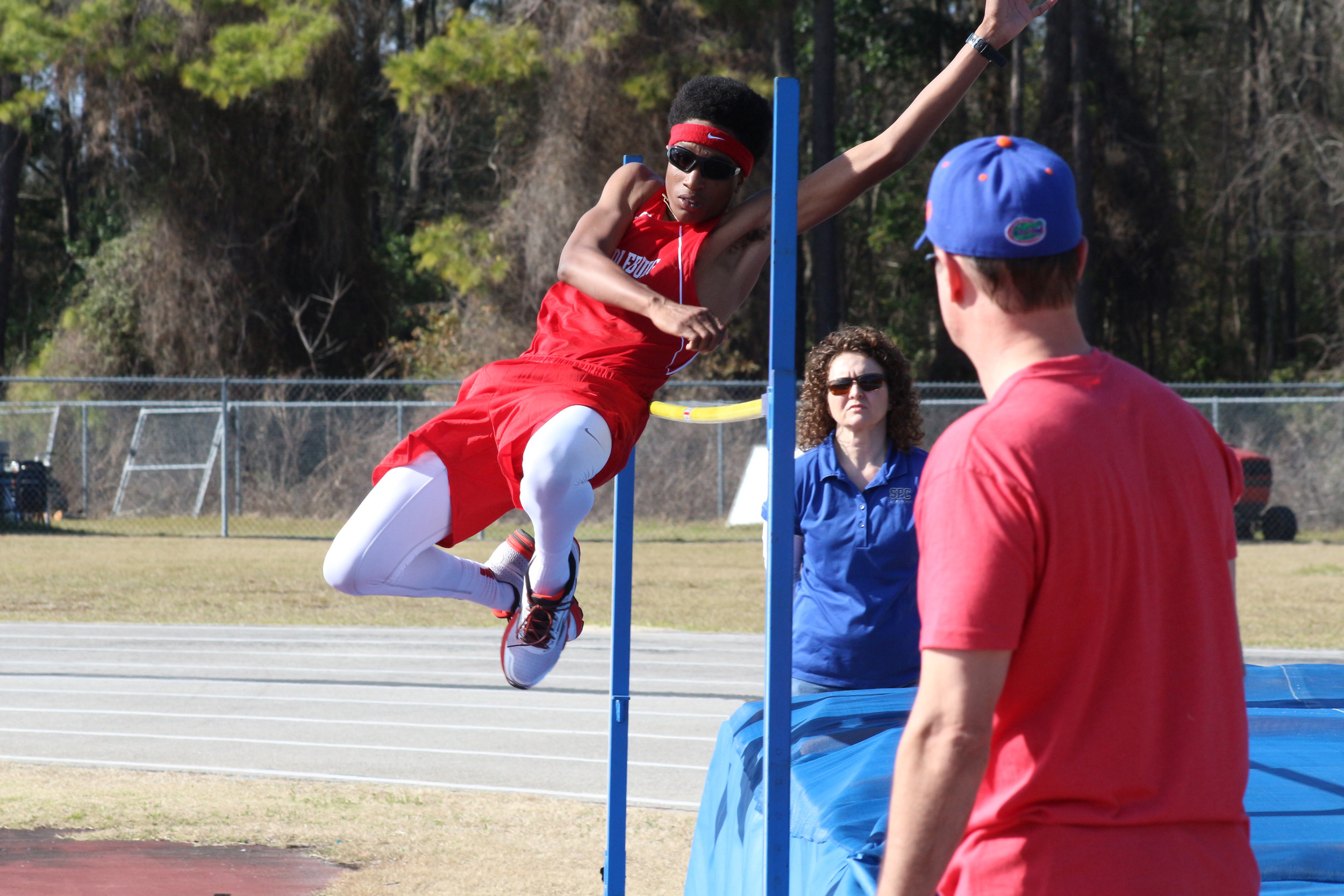Middleburg High high jumper Devon Tiptron is stylish in his red head band as he attempts a five foot high jump at the Panther Track Invite.