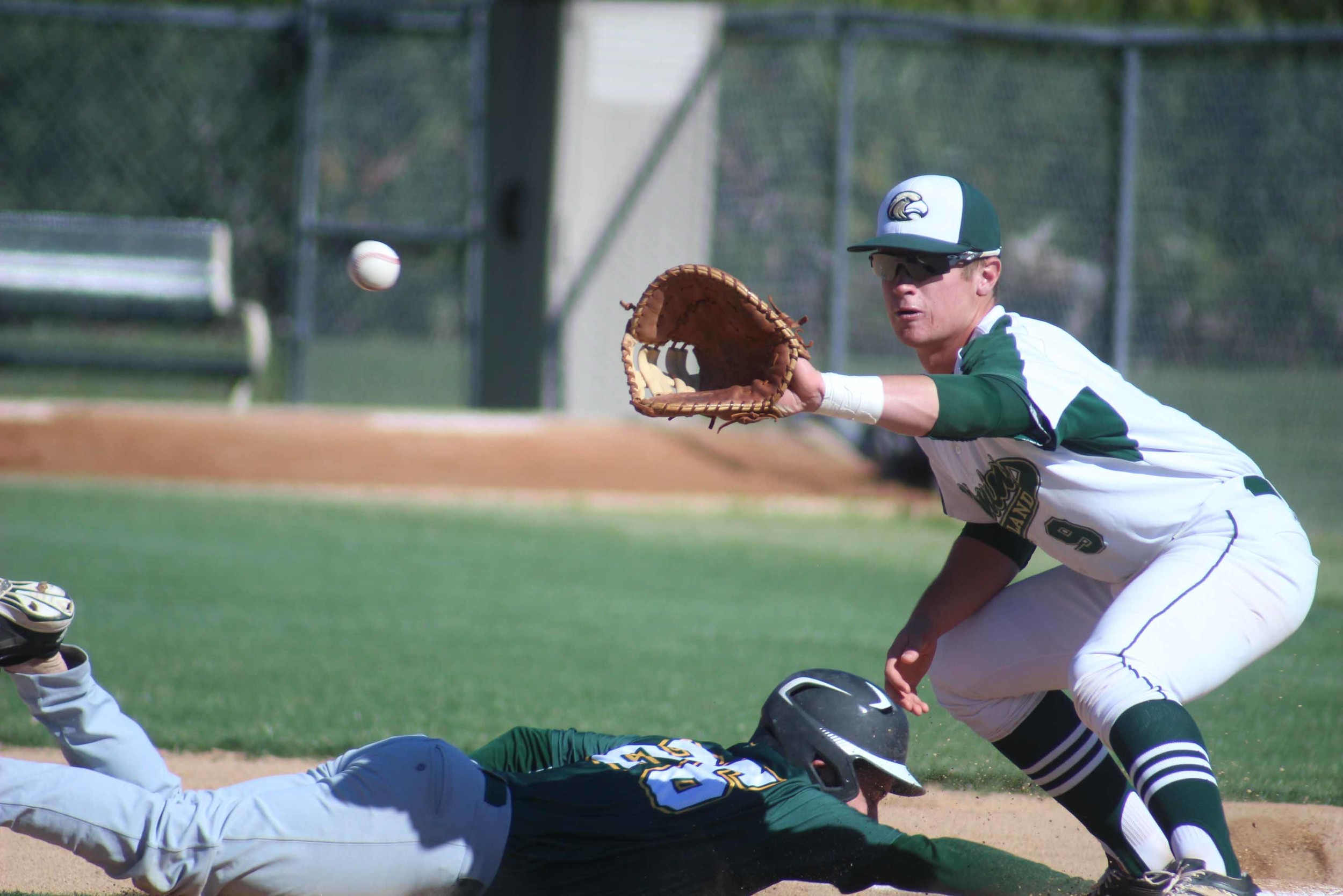 Fleming Island High first baseman Matt Whetstone awaits ball in pick off attempt in Golden Eagles 10-1 win over Yulee on Mon., March 21. Eagles go on the road to take on three returning regional teams; Chiles, North Florida Christian and Creekside.