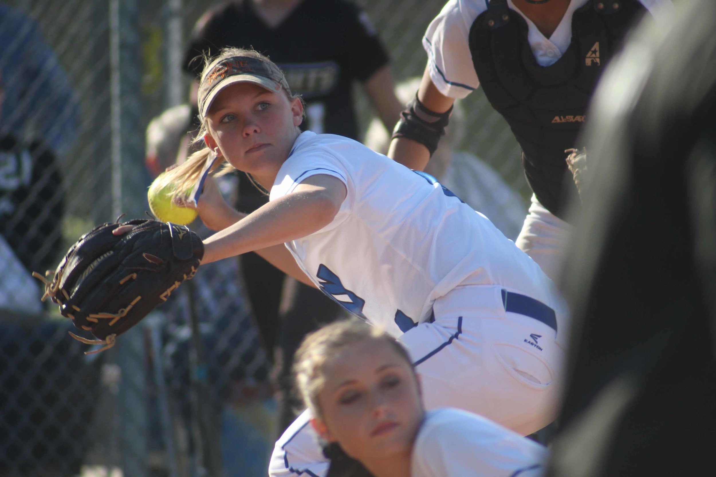 Clay High third baseman Hailey Stone eyeballs first base after fielding bunt attempt in sixth inning in Blue Devils 7-1 non-district loss to top-ranked in Florida Oakleaf High School on Tues., March 22.