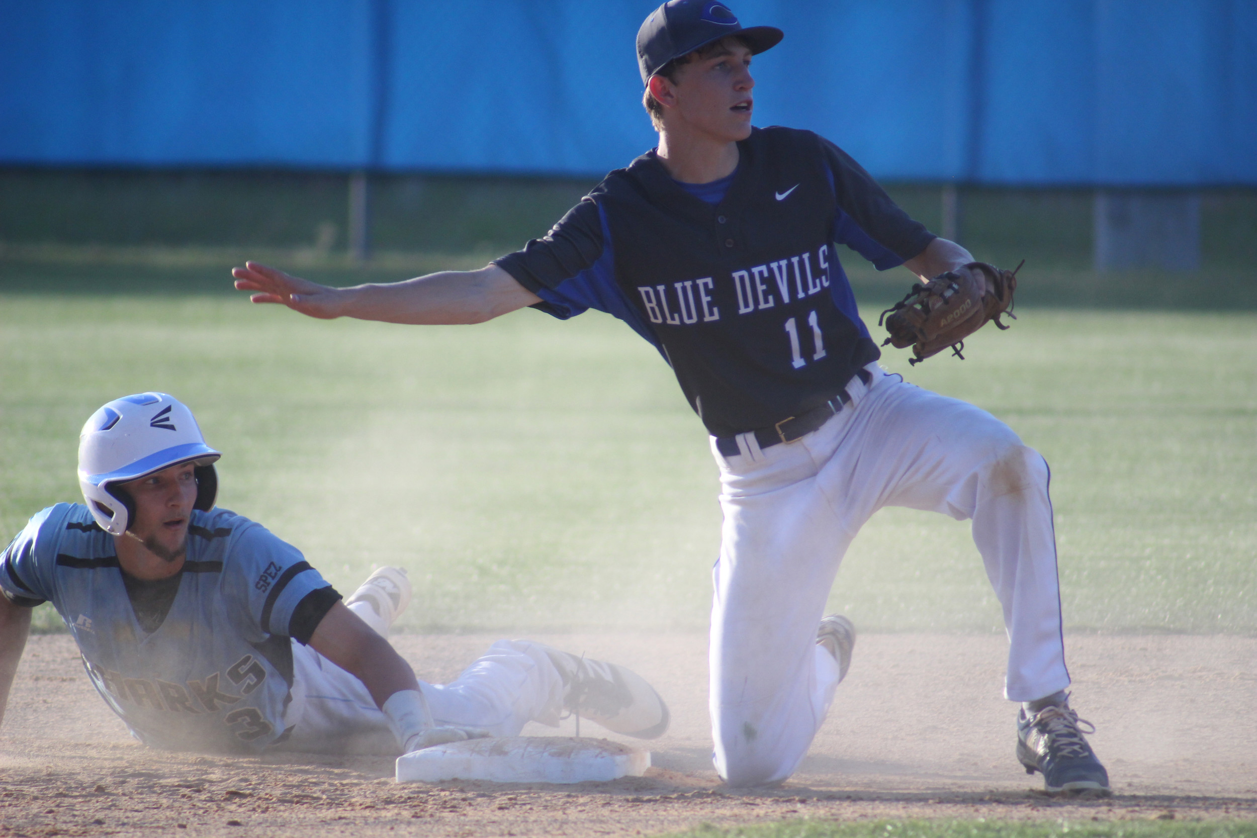 Clay High second baseman Austin Burke finishes off successful pickoff of Ponte Vedra baserunner in Blue Devils' second loss in three days to Sharks. Clay needs the right formula to upend Sharks in district tournament next week.
