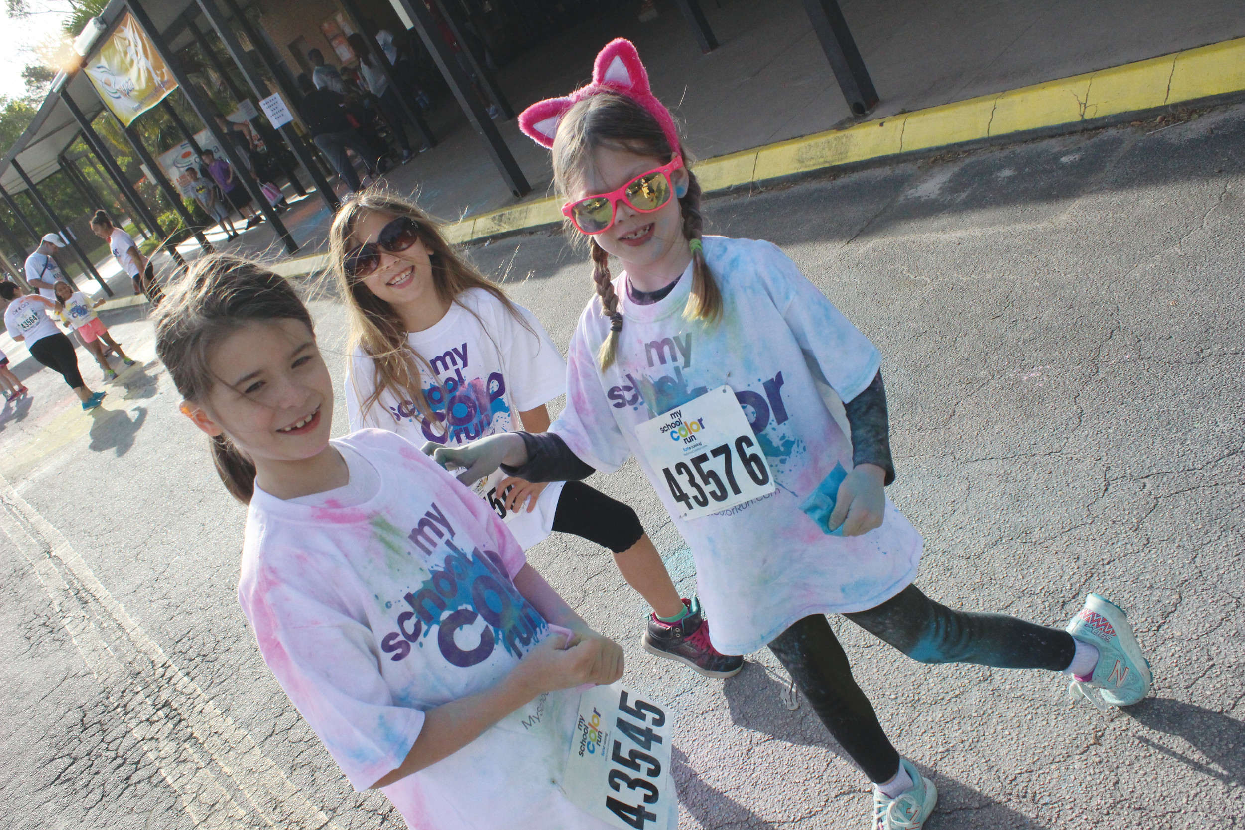Three somewhat decorated runners, left to right, Savannah Martinez, Trisstin Quiett and Raven Shannon, get set for some running action at the OPPAA Color Me Rad 5k.