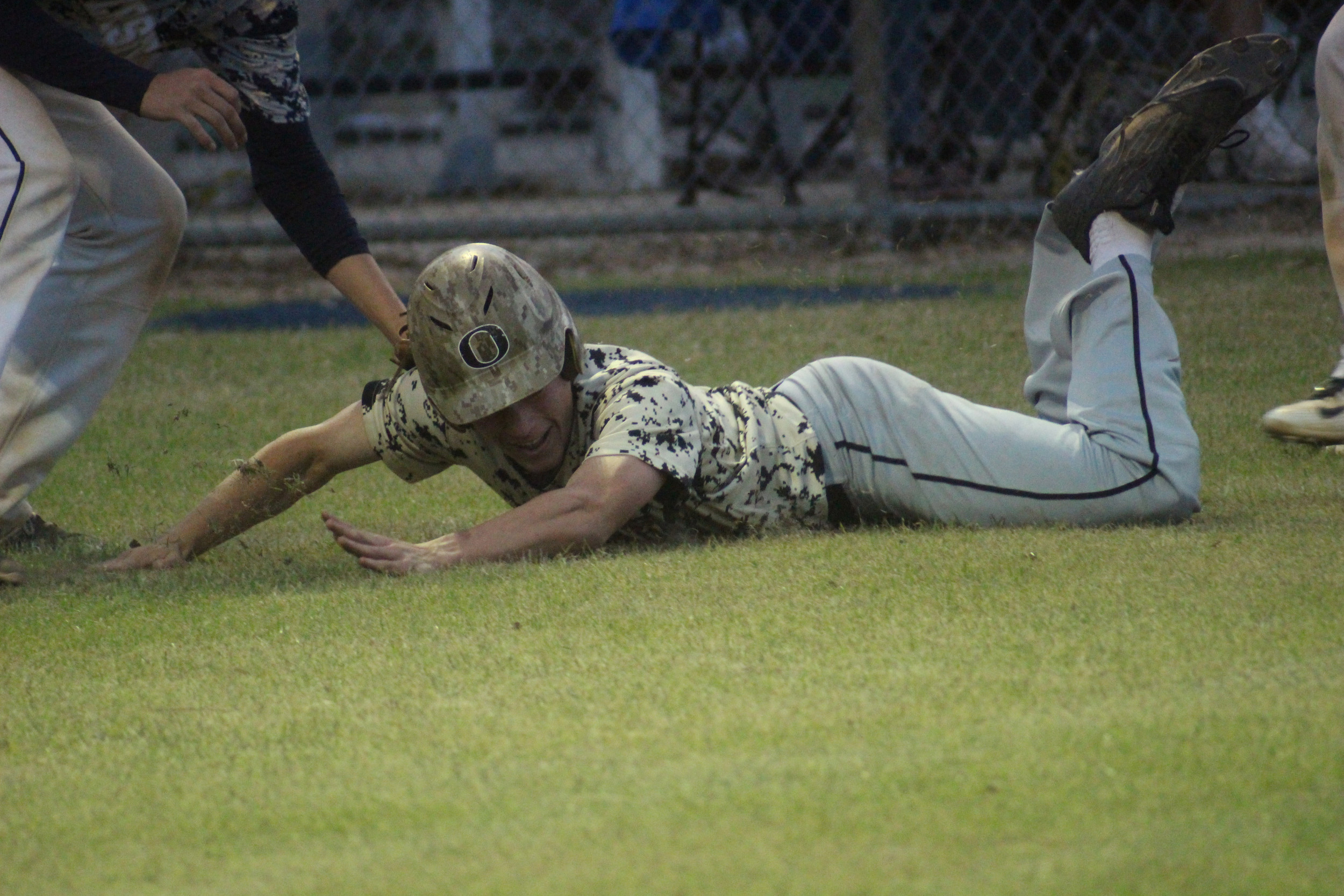 Oakleaf High baserunner Keegan Barrs gets snagged on a third base rundown in Knights 3-2 loss to 3A-University Christian Monday night in Jacksonville.