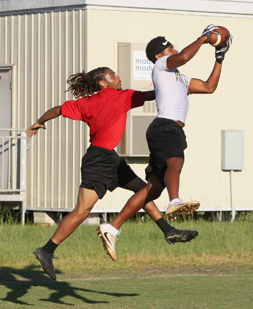 Oakleaf High defender Kwame Clark snags interception in front of Broncos wide out Terron Allen.