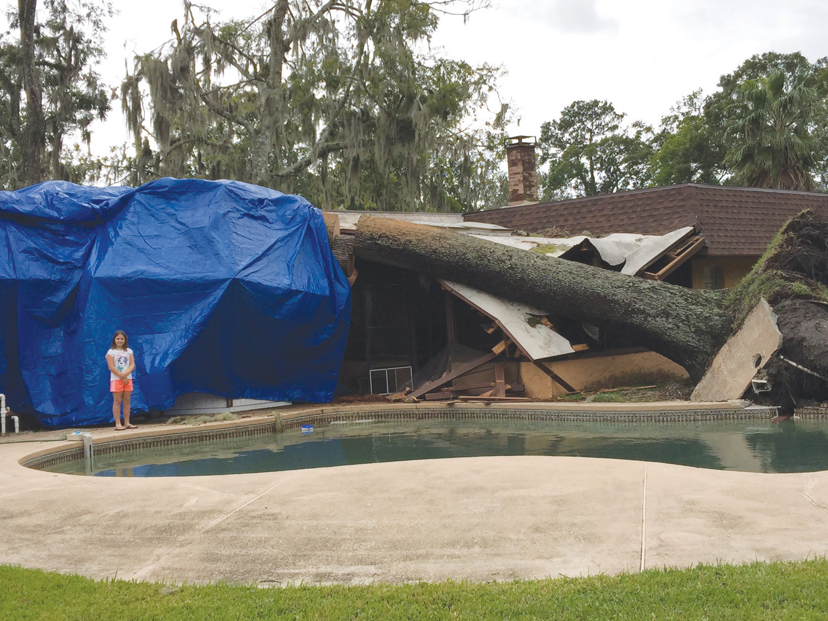 Gene Parker's home in the 1400 block of Clover Avenue in Orange Park took a hit from the after affects of Hurricane Matthew when an oak tree crashed on his roof while taking out part of the decking around the pool.