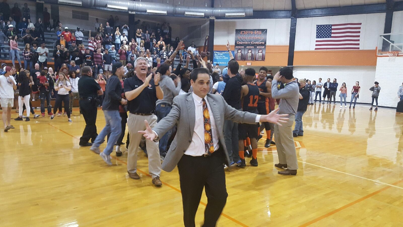 Orange park basketball coach Derek Kurnitsky is all smiles after Raiders beat Baker county 60-52 in district 4-6A final. Raiders are only county team in state playoffs.