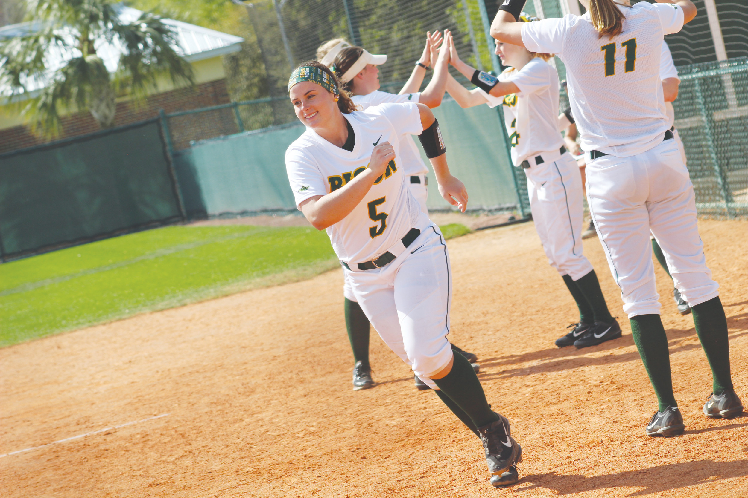 North Dakota State University softball pitcher K.K. Leddy smiles during introductions in game against Columbia University Saturday in Deland.