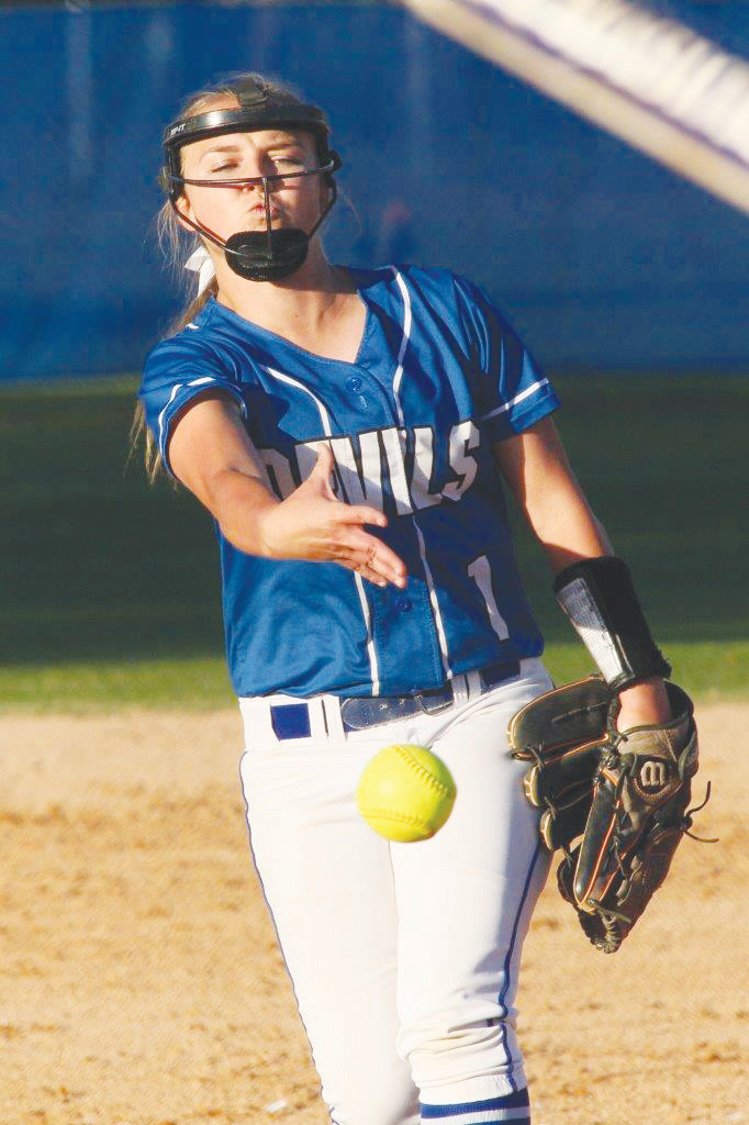 Clay High third baseman Hailey Stone pushes for tag of Baker County baserunner in Wildcats 6-0 win over Blue Devils.