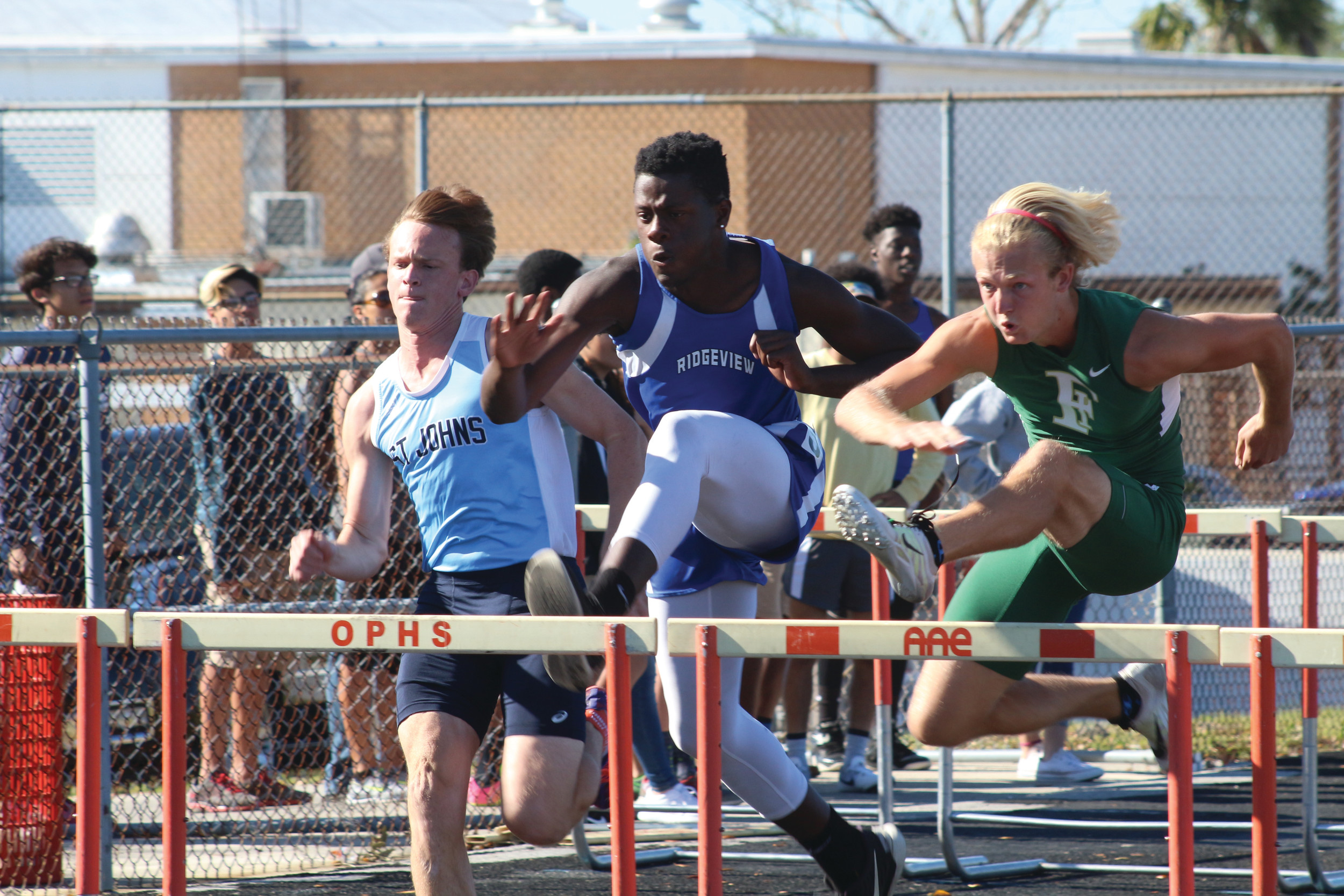 Ridgeview High hurdler Glenn Rodgers, center, is top choice for top four finish at April 25 regions after advancing with district championship in 110 high hurdles with teammate Joaquin Castro also advancing with a third place district finish.