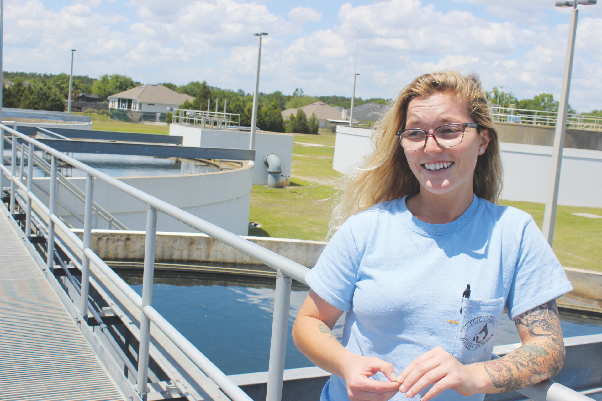 Lindsey Estevez stands overlooking a water treatment tank at the Spencer's Crossing wastewater plant in Oakleaf. She said she would have never learned about what is now her career path if not for an internship designed to entice a younger generation into a greying workforce.