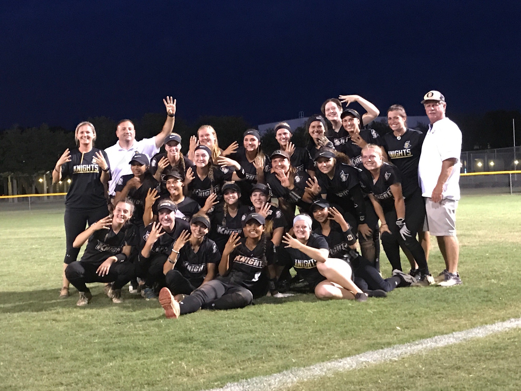 Oakleaf High's softball team show off their Final Four hand signal after defeated Wharton High 8-0 in the region 1-8A championship game in Tampa on Friday. Lady Knights, ranked second in Florida, take on St. Thomas Aquinas on Fri., May 19 in the state semifinal at Dodgertown Stadium in Vero Beach with shot at state title on Saturday with a win.
