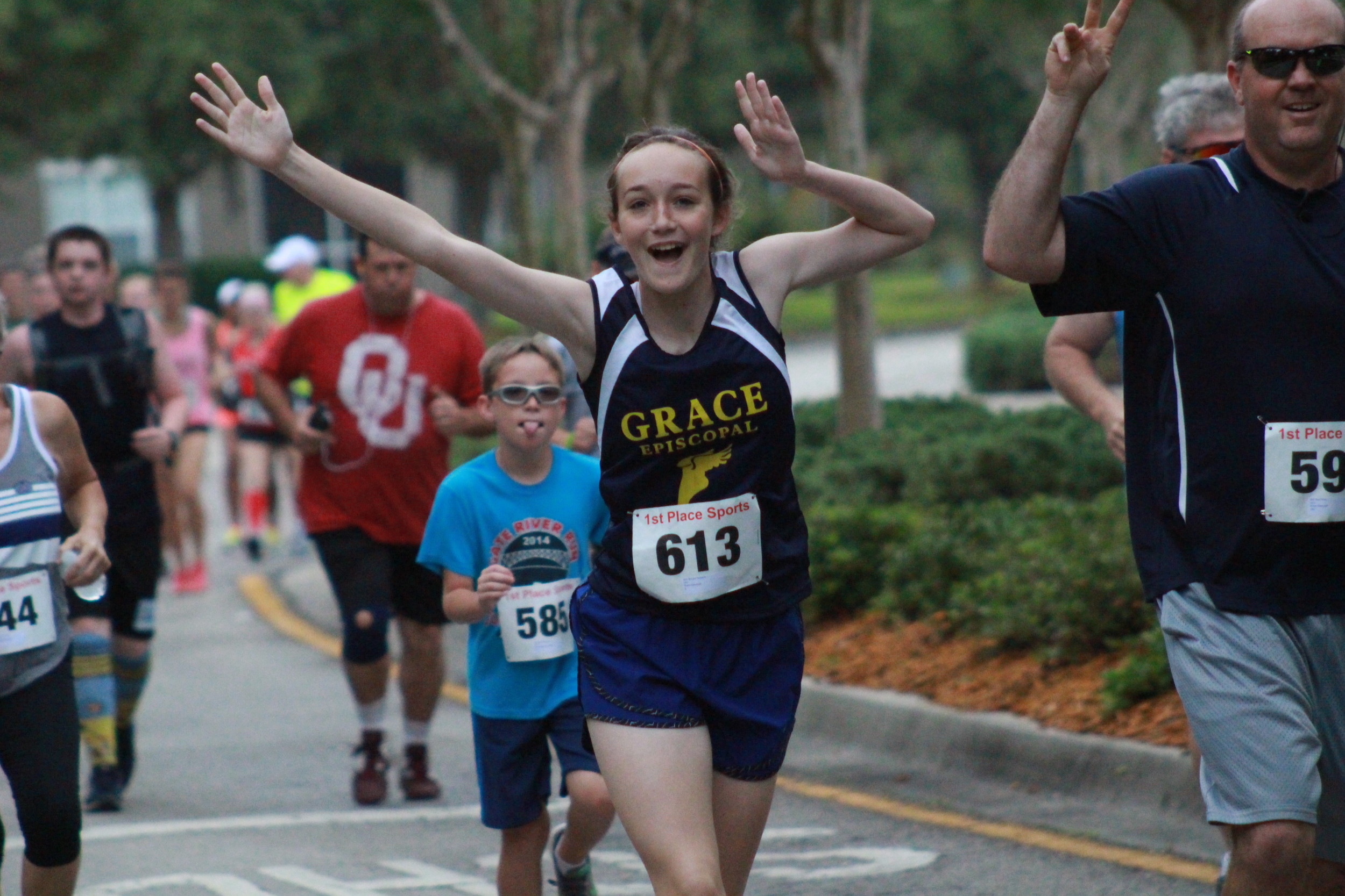 Grace Episcopal runner Brooke Remolde smiles at the one mile mark.