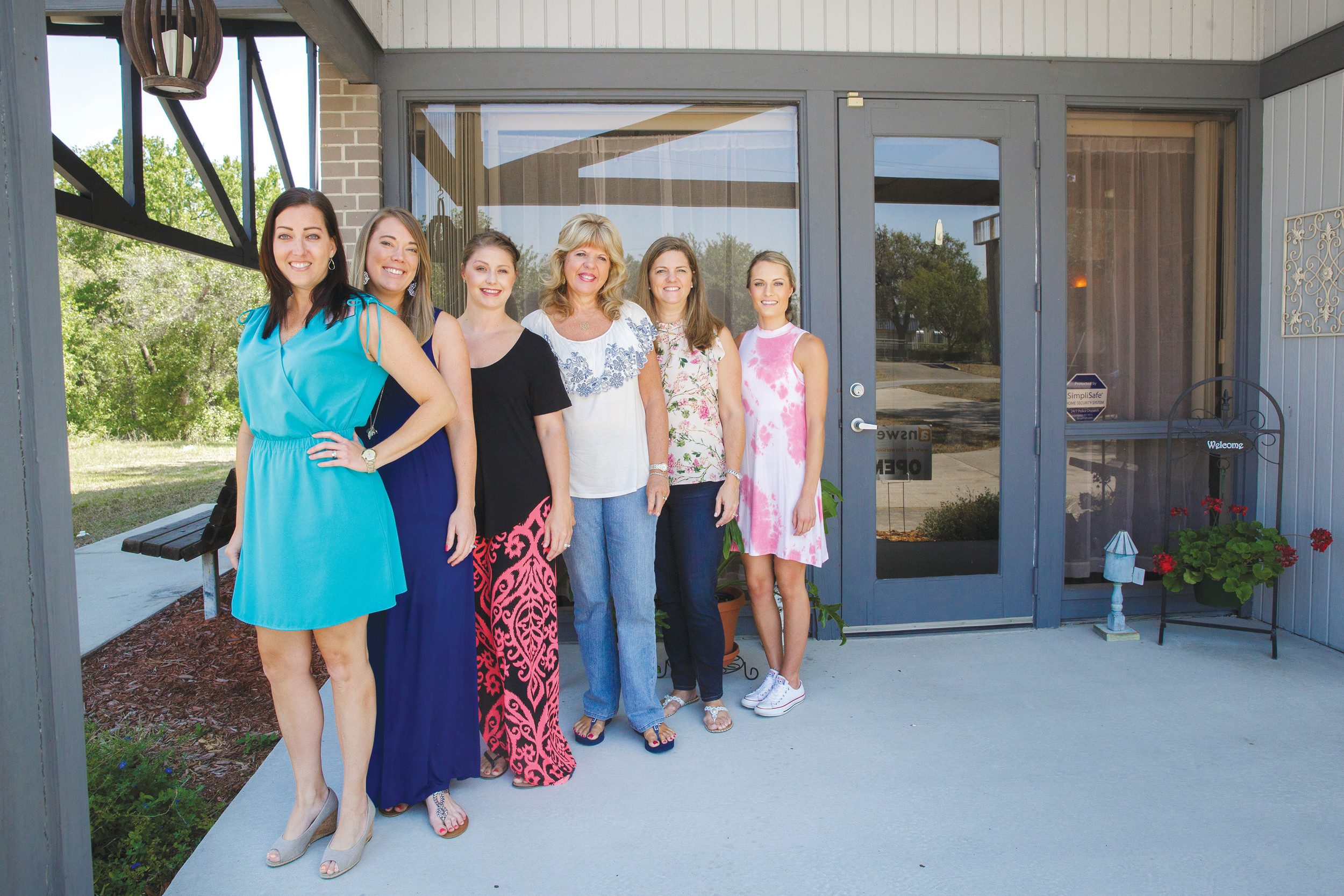 Answers CEO JoAnna Weldon, left, poses with her staff outside their Keystone Heights office. Answers offers counseling and pregnancy testing for women and will soon open a second location in Starke.