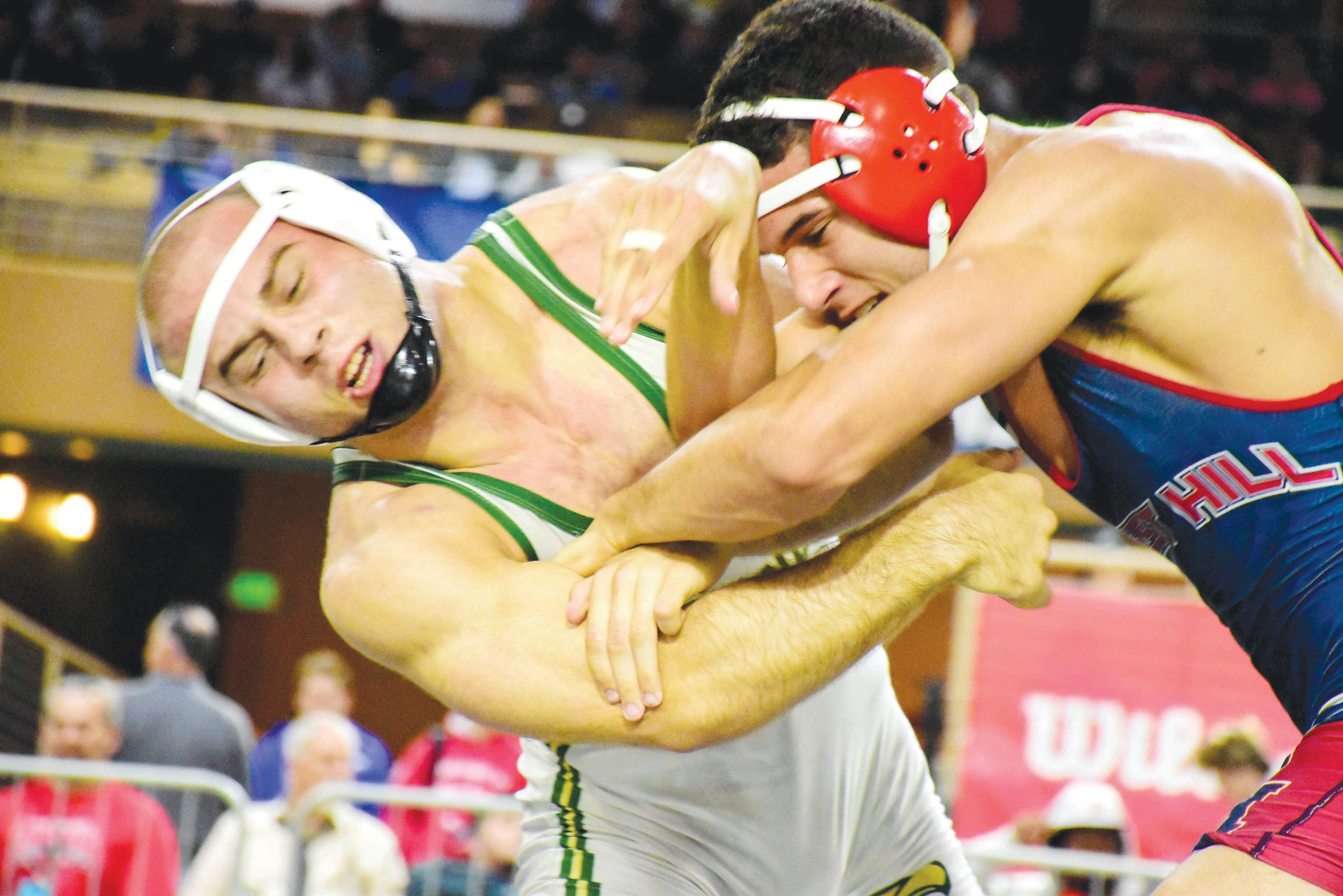 Fleming Island High's first wrestling gold medalist, Jason Davis, left, made preseason transition to lighter weight that eventually paid dividends.