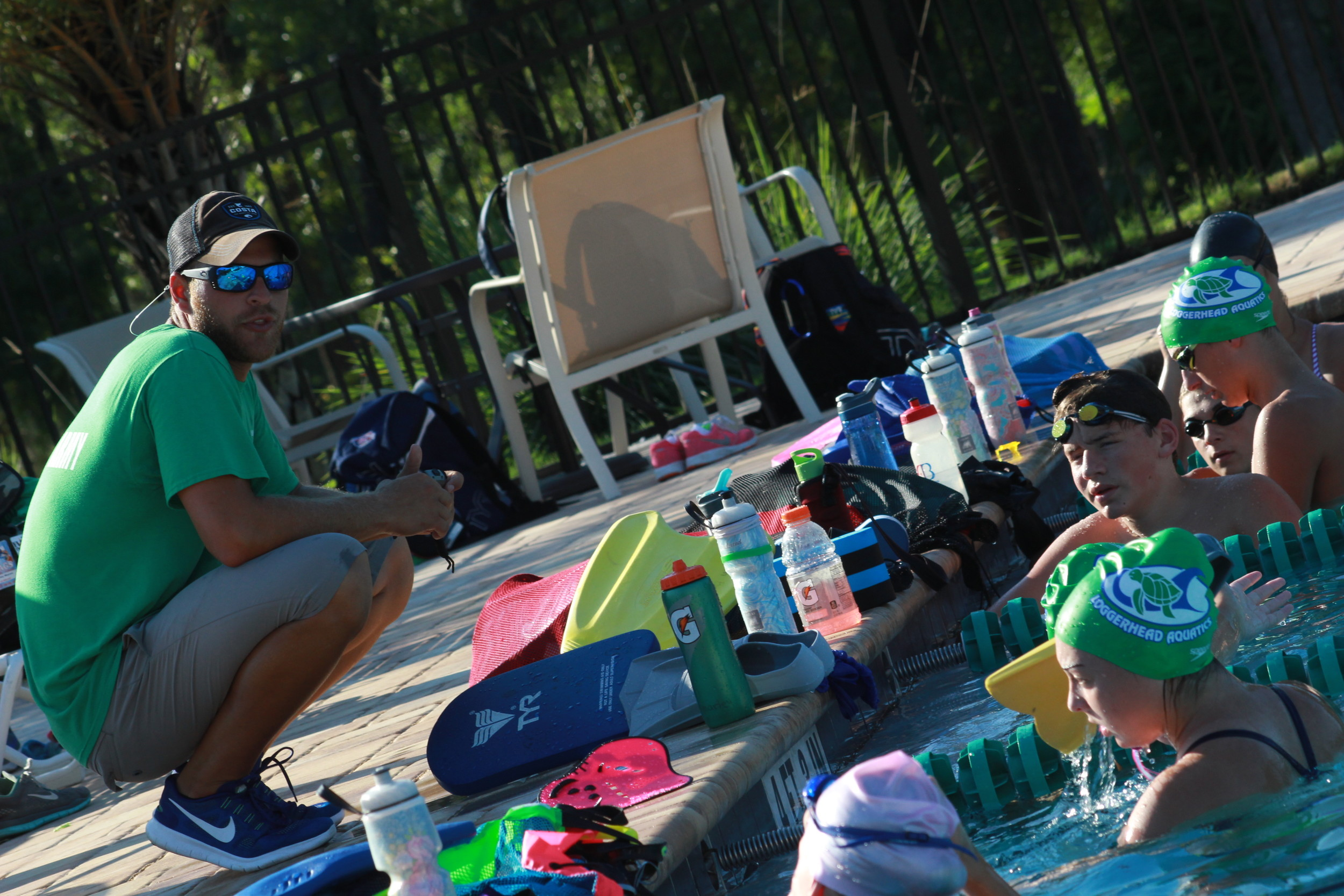 Fleming Island High graduate Kyle Casias supervises recent swim session at Magnolia Point Golf and Country Club as he undertakes to build strong aquatics program for area swimmers.