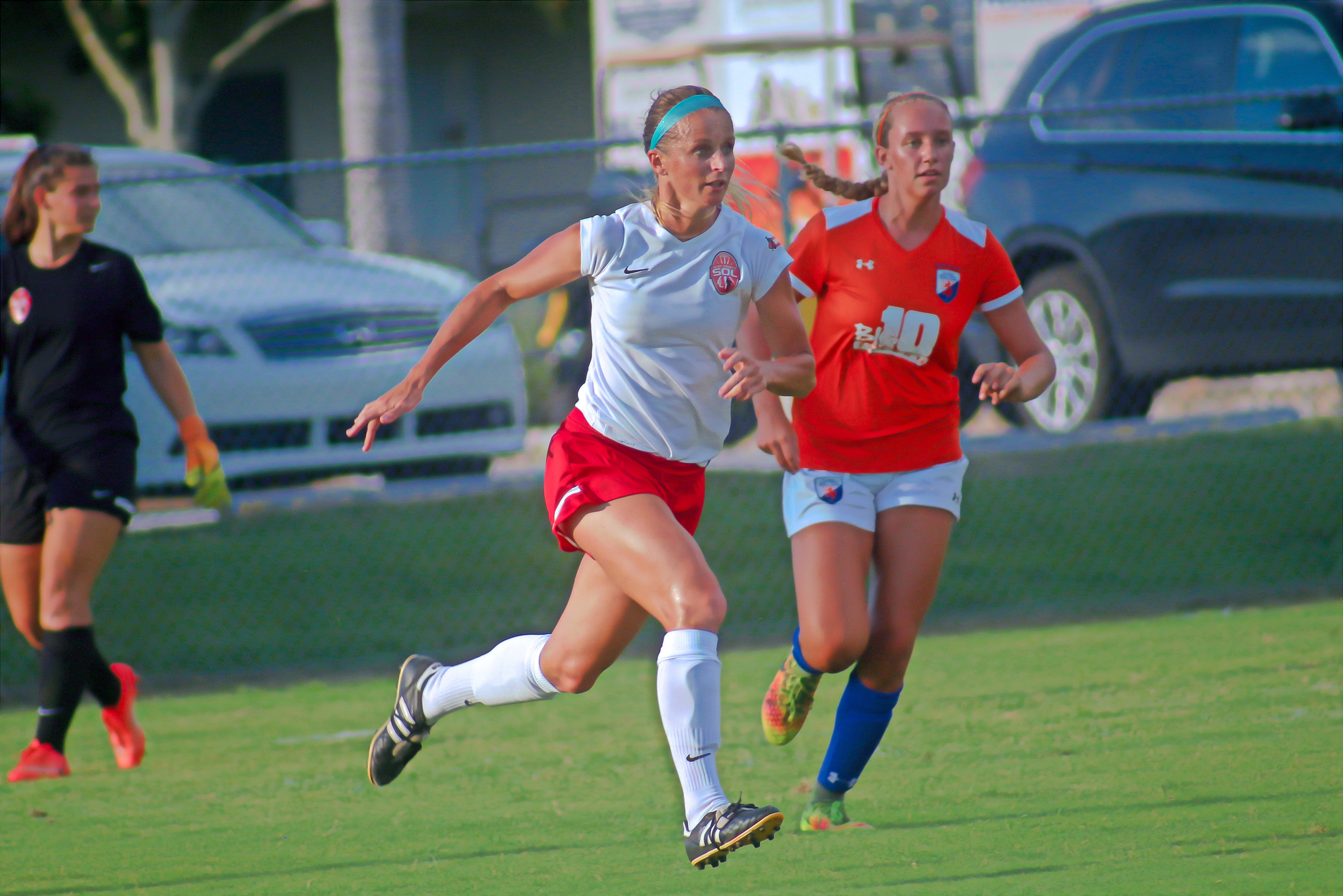 Florida SOL FC defender Brianna Oeser chases after loose ball in SOL's 3-0 win Friday night against Florida Gulf Coast Dutch Lions FC. SOL was set to play Sunday, but rain cancelled the match against Florida Krush. SOL ends season at 5-3.