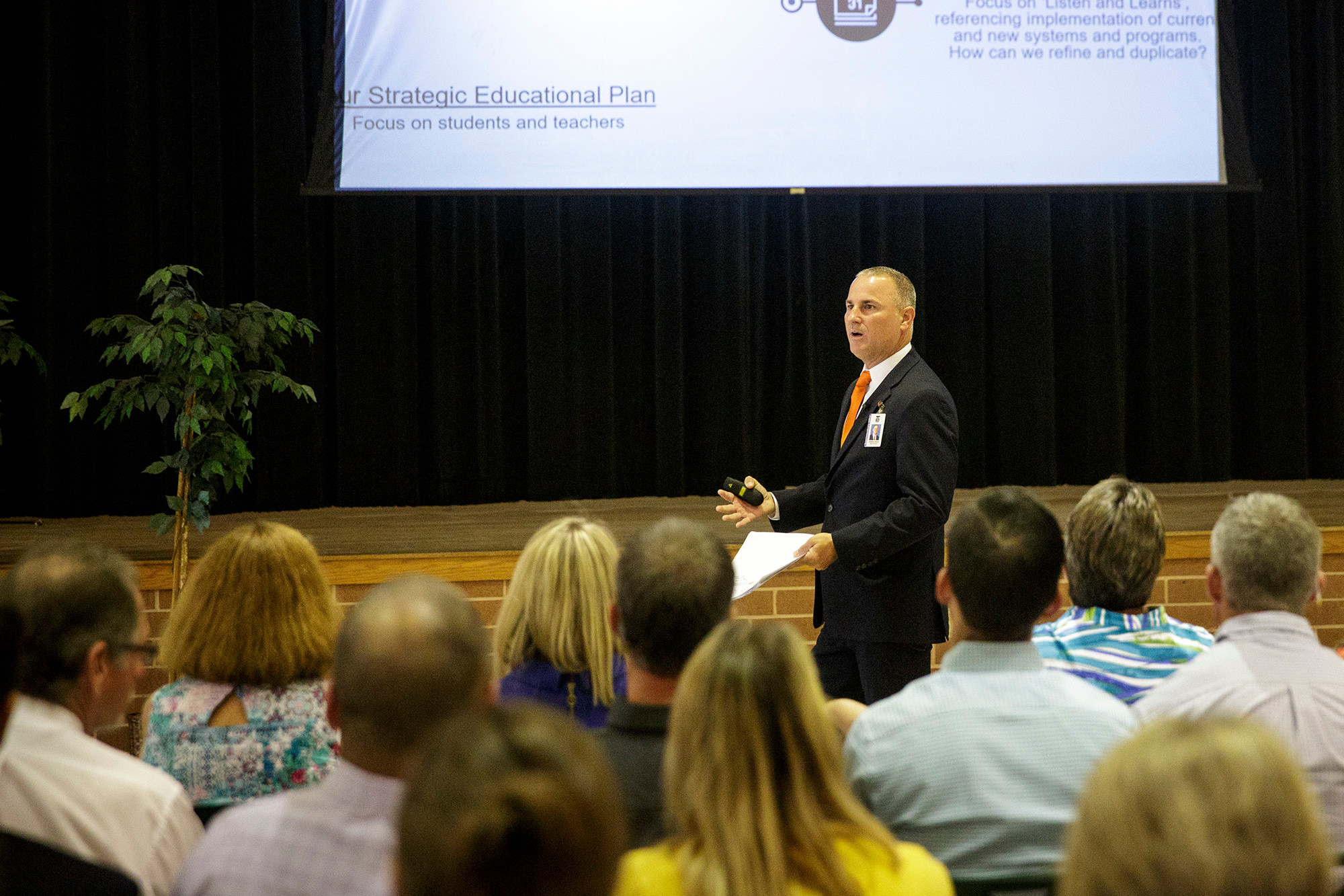 Clay County Public Schools Superintendent Addison Davis speaks to a group of administrators from across the district Tuesday at Fleming Island High School during the annual administrators luncheon.