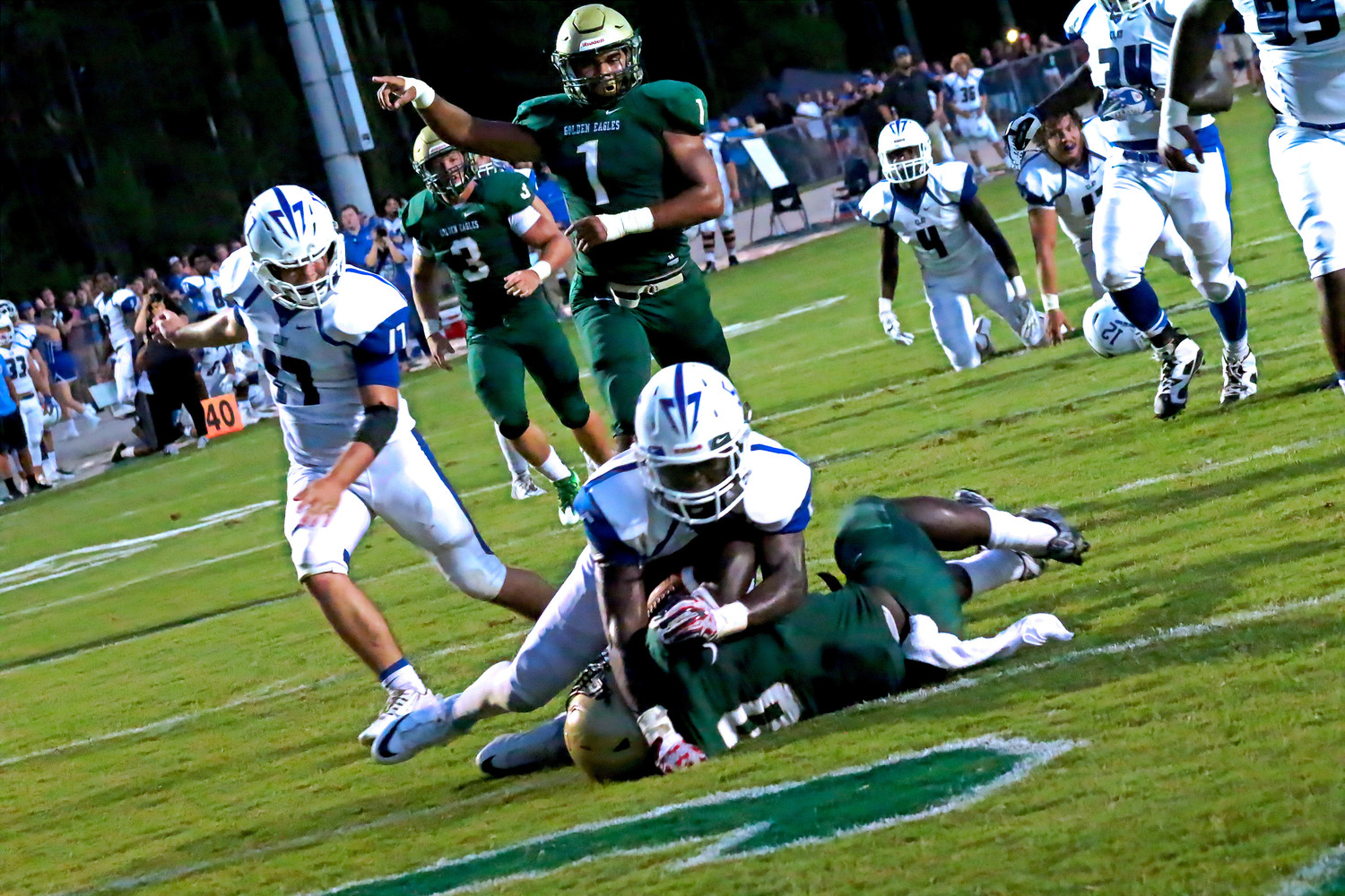 Returning senior fullback Chauncey Garrison pushed for 151 yards and this go-ahead score in the first half that tied the game at 7-7 in the first half.  Garrison suffered season-ending injury in game, but is set to run again in 2017.