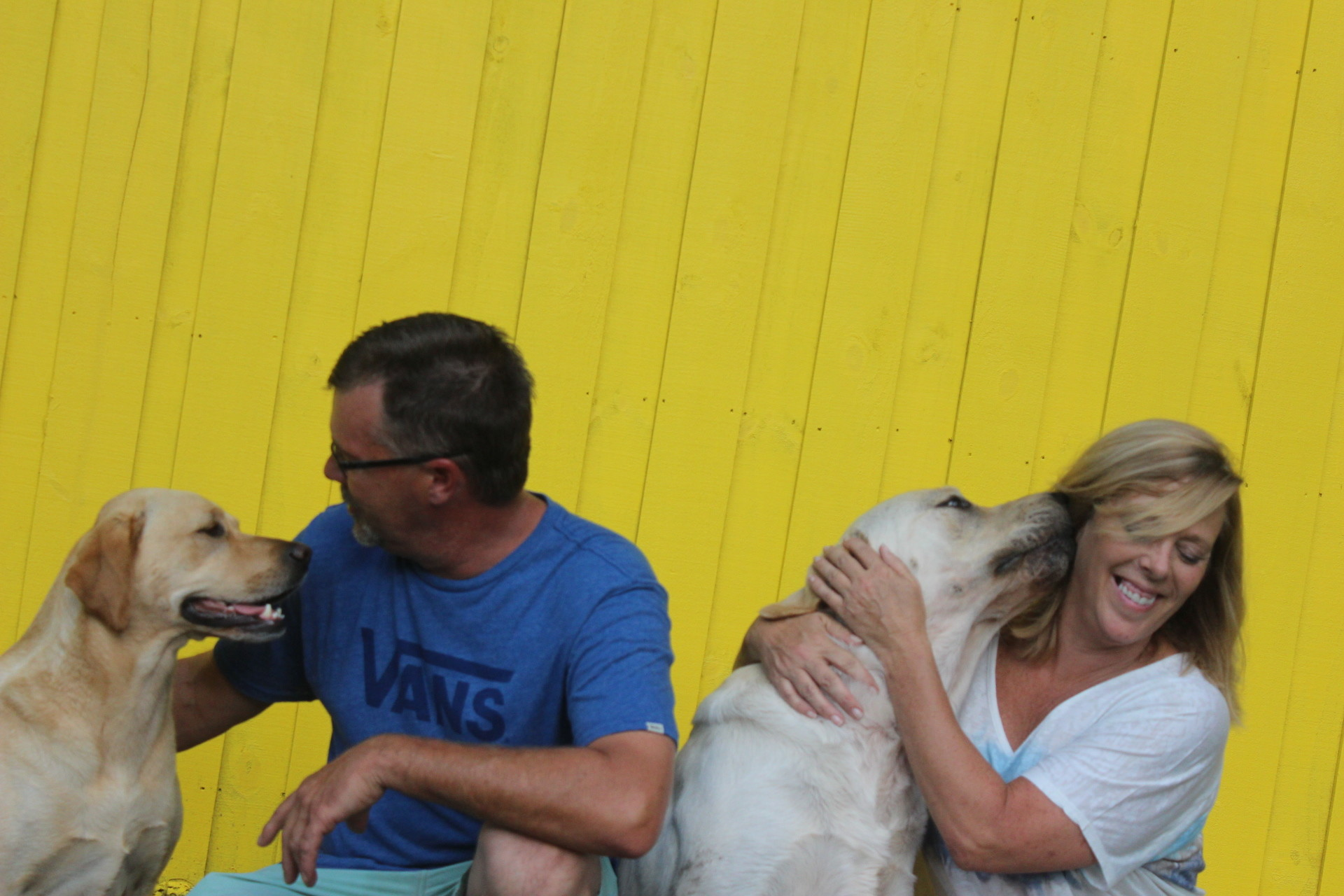 From left, Mark and Denise Umphress carress their dogs, Cleo and Buddha.