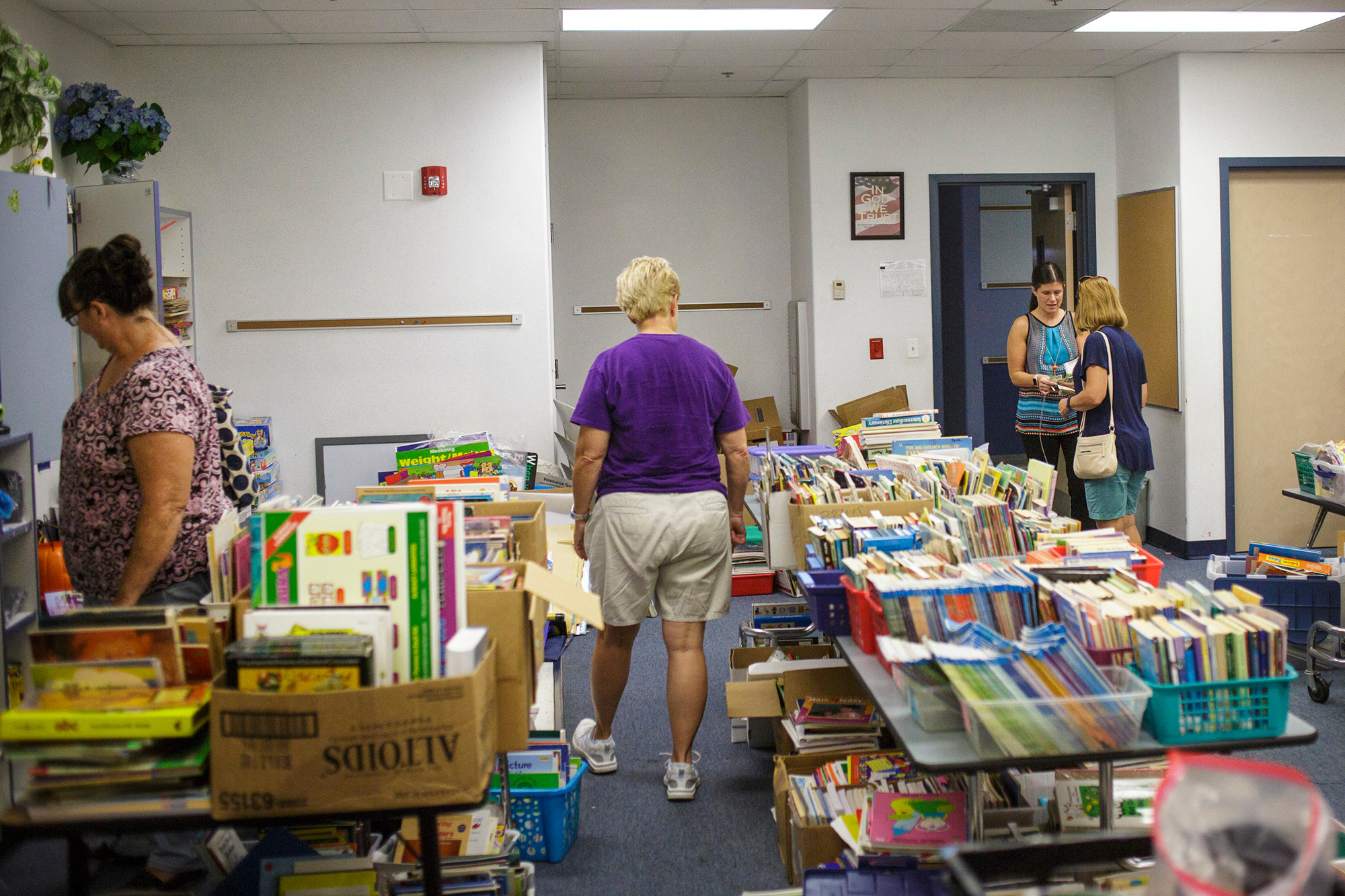 Teachers from Robert M. Patterson Elementary School stopped by Thunderbolt Elementary School Tuesday after class to browse unused items for sale in the Kudos to Karen teacher depot.