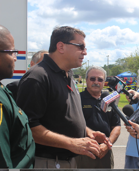 Clay County Emergency Management Director John Ward speaks to reporters Tuesday Morning at Middleburg High School.