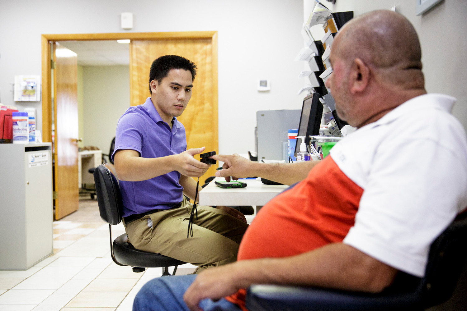 Volunteer Stephen Marcos checks a patients pulse Tuesday afternoon at The Way free medical clinic in Green Cove Springs. After some leadership and financial woes, the clinic is looking to the community for help to rebuild.