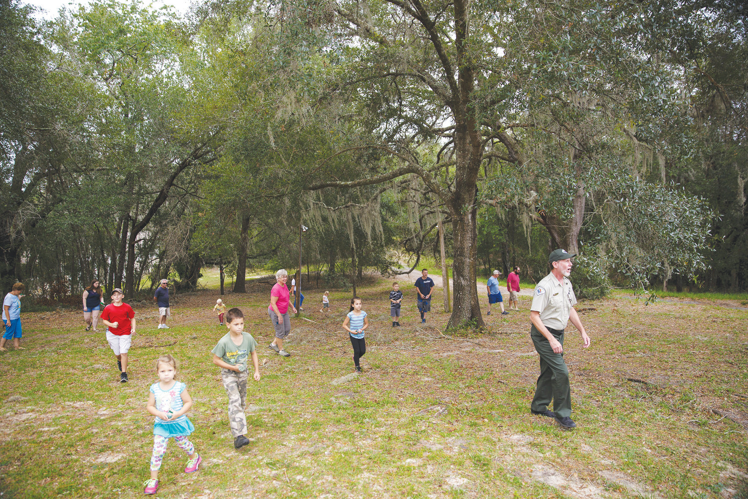 Park Ranger Steve Earl leads participants on a scavenger hunt during Gold Head Branch State Park's annual Read with the Trees event.