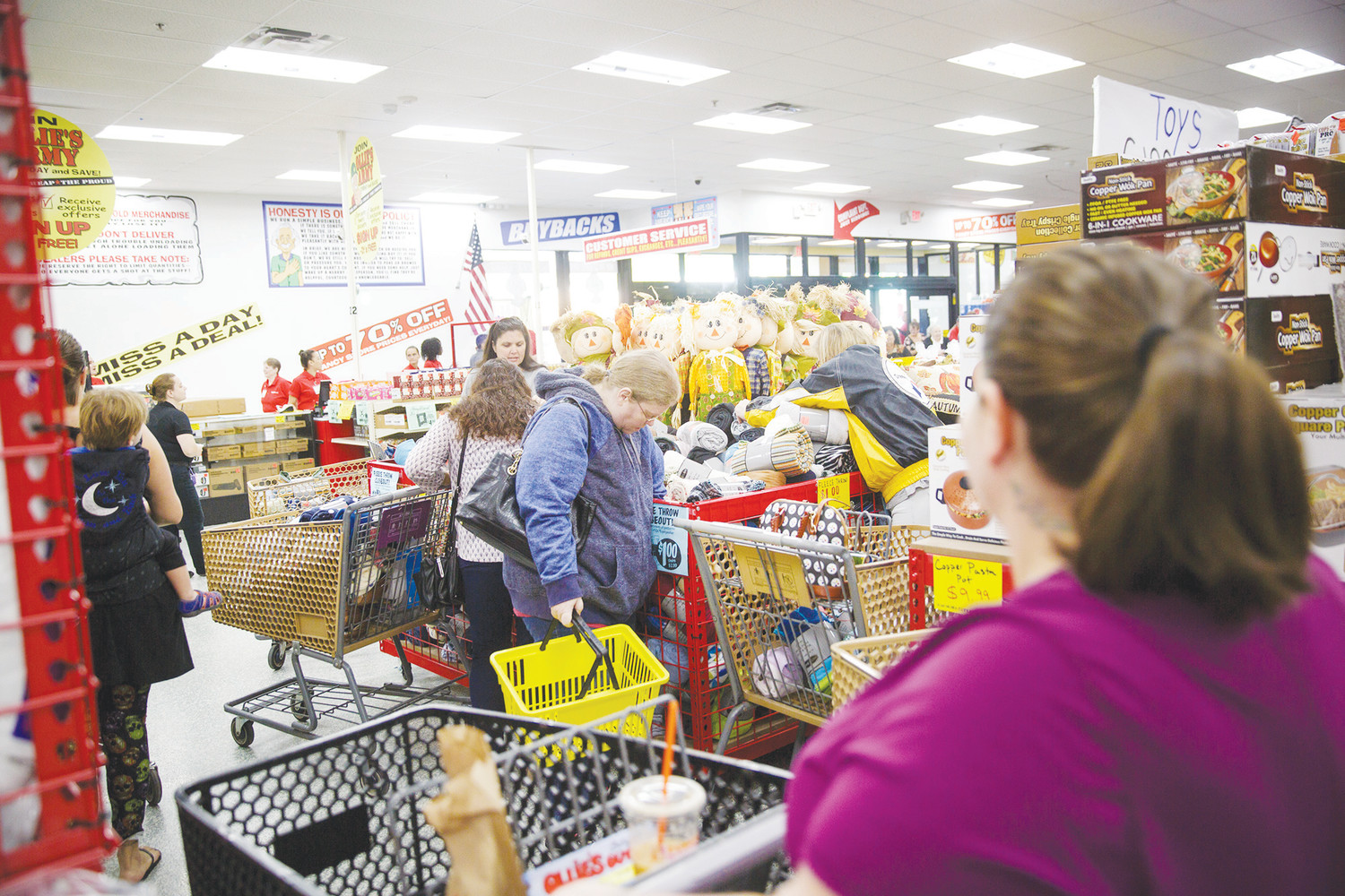 Customers stormed to the $1 fleece throw bin Wednesday morning at the grand opening of Ollie's Bargain Outlet on Blanding Blvd. in Orange Park.
