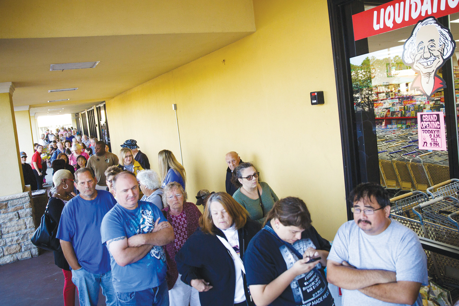 A line wrapped around the shopping center Wednesday morning starting at the front door of Ollie's Bargain Outlet which was holding a grand opening event starting at 9 that morning.
