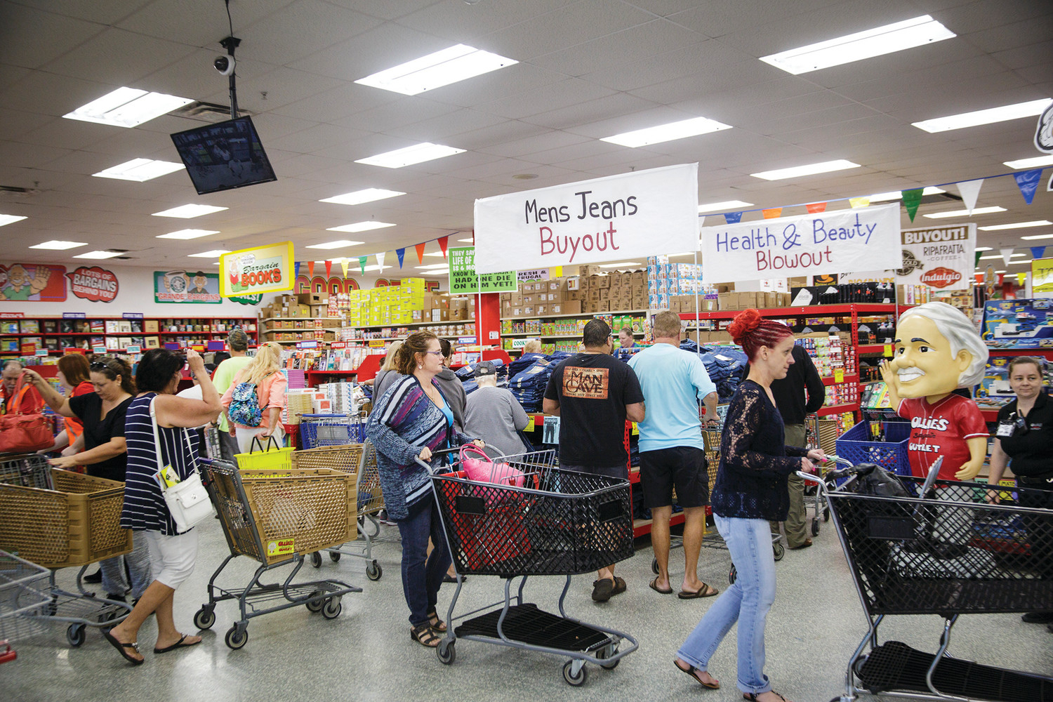 Customers flood into Ollie's Bargain Outlet Wednesday morning during the official grand opening. The store offers name brand items as discounted prices.