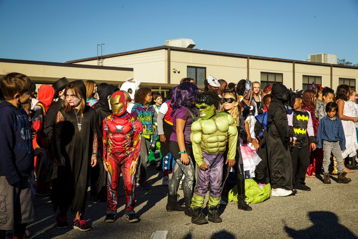 "Charles E. Bennett Elementary School students show off their costumes while dancing to Michael Jackson's ""Thriller"" Tuesday morning as part of a Halloween flash mob style dance routine organized by the school's music director Victoria Syken."