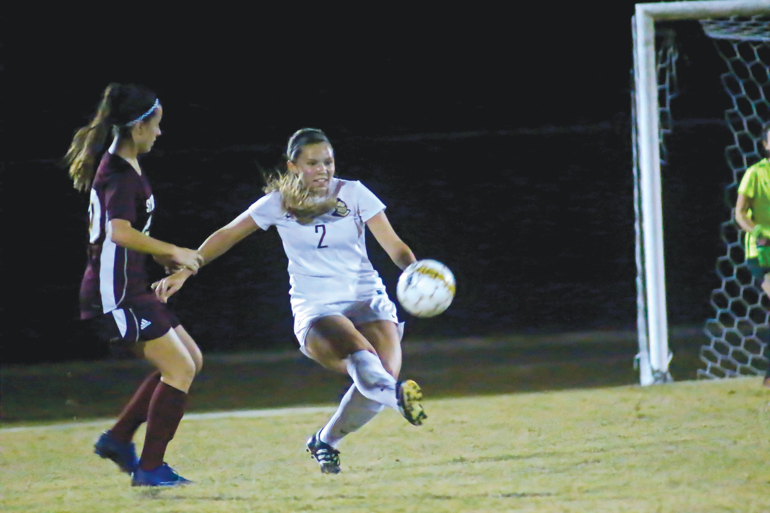 Oakleaf defender Meredith Bauman blasts St. Augustine ball out of Knights' defensive zone.