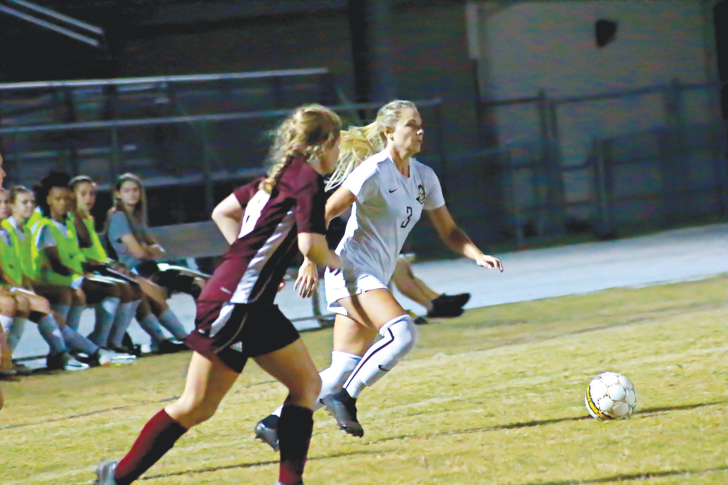 Oakleaf center midfielder Alyssa Farmer makes move around St. Augustine player to get ball downfield into offensive zone.