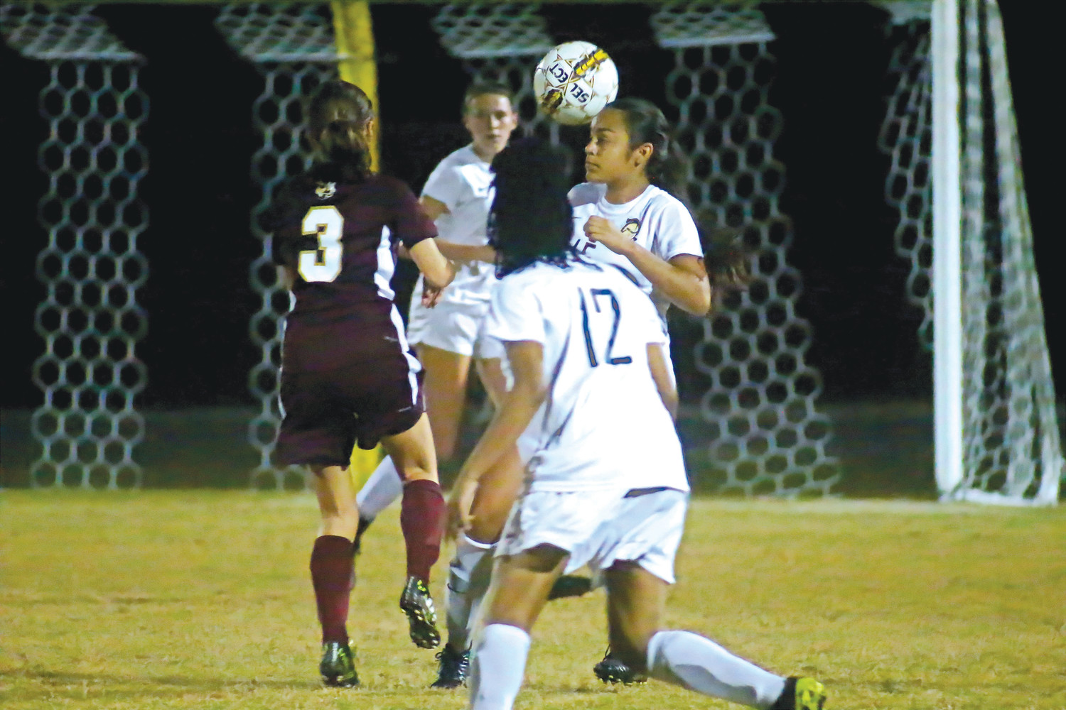 Oakleaf defender Brianna Olazabal gets a head on loose ball in front of Knights' net.