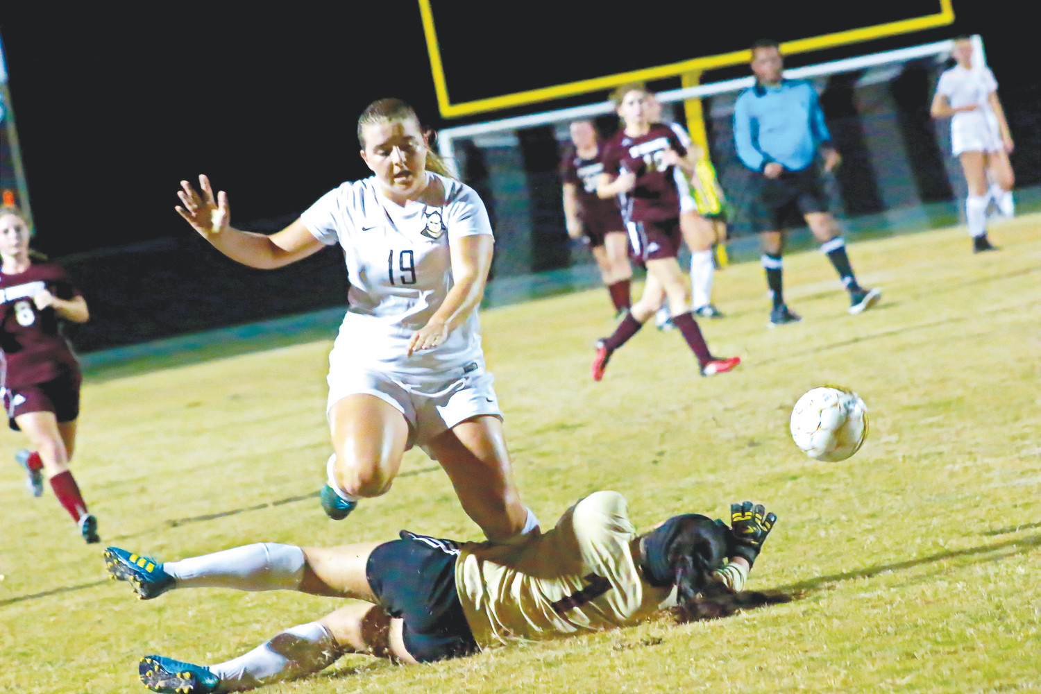 Oakleaf forward Micaela French barrels over St. Augustine goalie in effort for loose ball. French scored a goal in first half of Knights' 9-1 district season opener on Nov. 6.