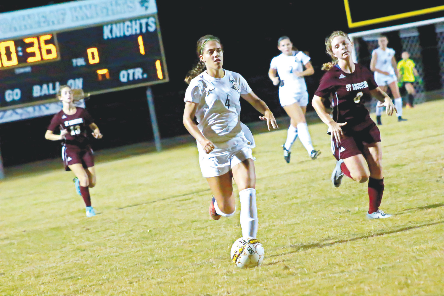"Oakleaf High soccer forward Michelle ""K-Smash-Ski"" Kanaski flies downfield en route to one of her three goals for Lady Knights in 9-1 season opening district win over St. Augustine."