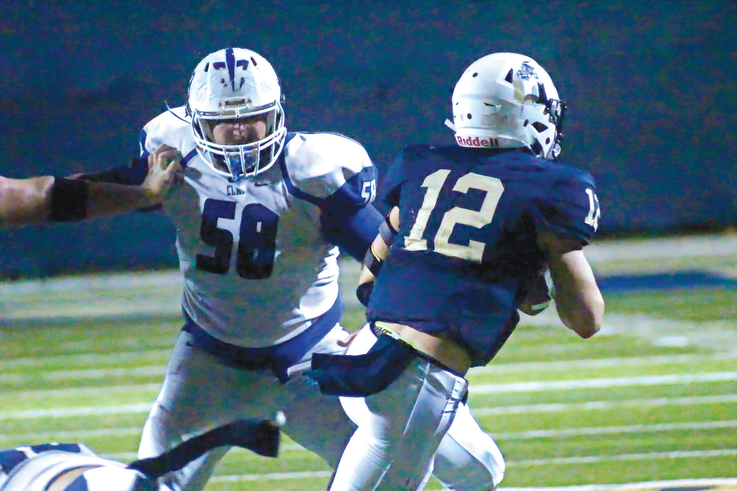 Clay High defensive tackle Colby Butler eyeballs University Christian quarterback in Blue Devils win Nov. 3 that propelled Clay into the Class 5A state playoffs.
