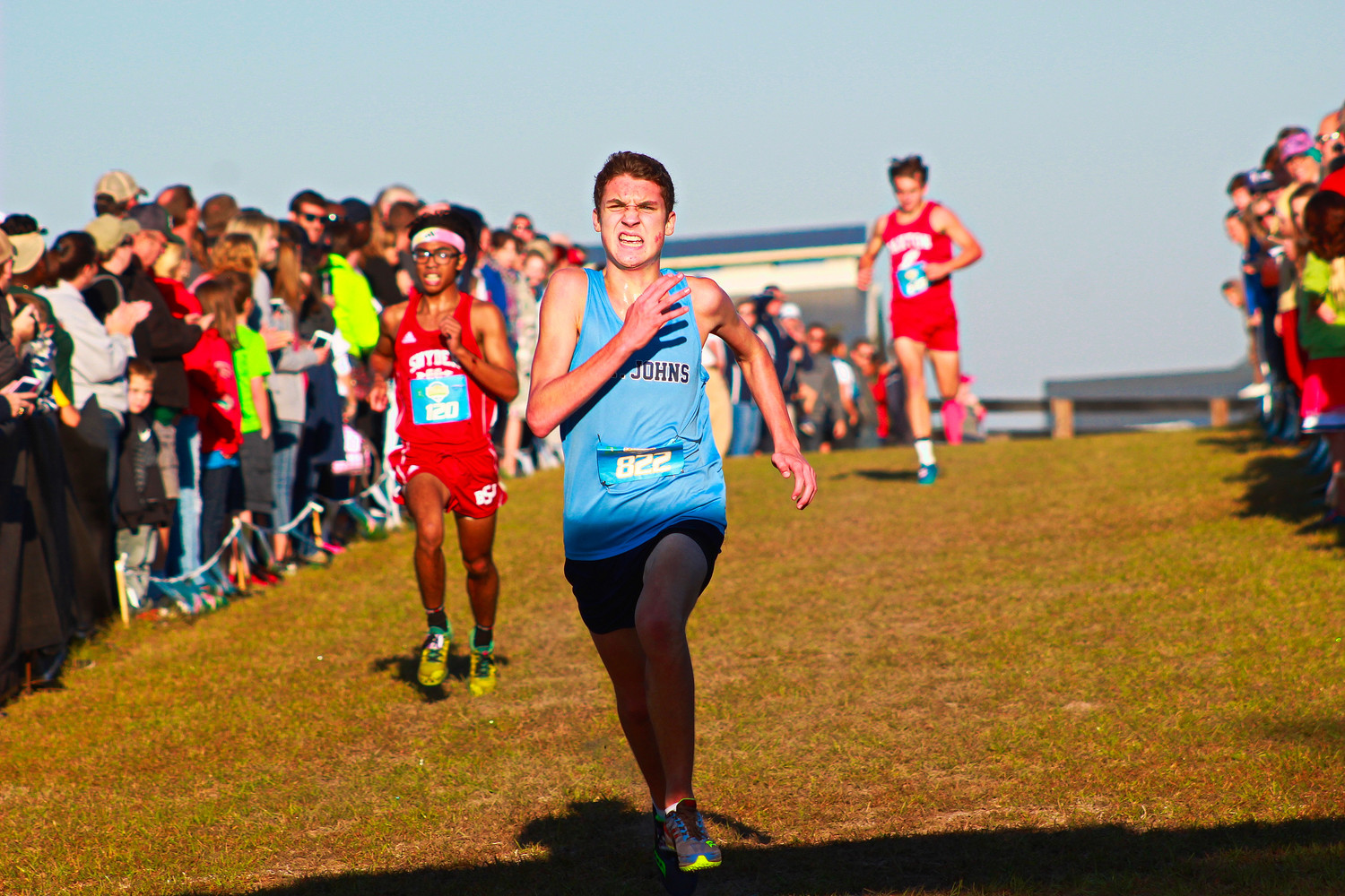 St. Johns Country Day School sophomore Ben Kailes sprints to region finish line.